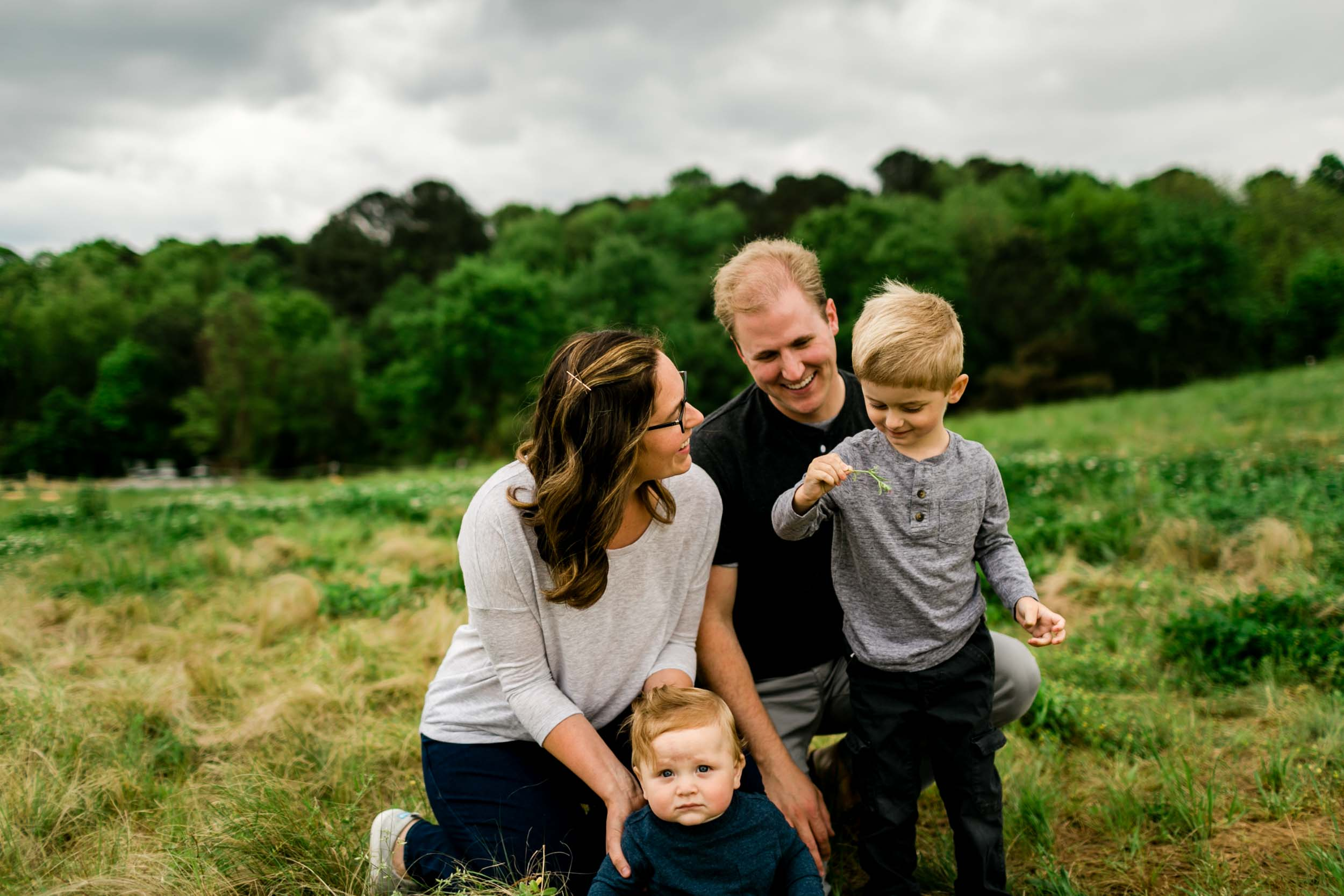 Organic family photo outside during spring time | Durham Family Photographer | By G. Lin Photography
