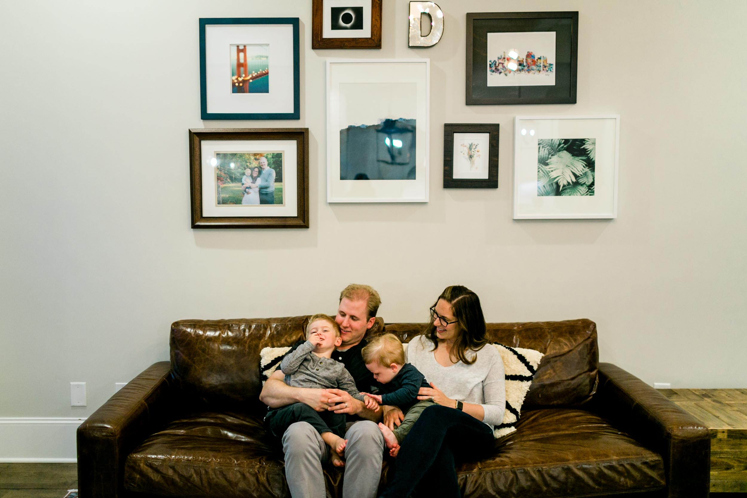 Family sitting on couch | Durham Photographer | By G. Lin Photography