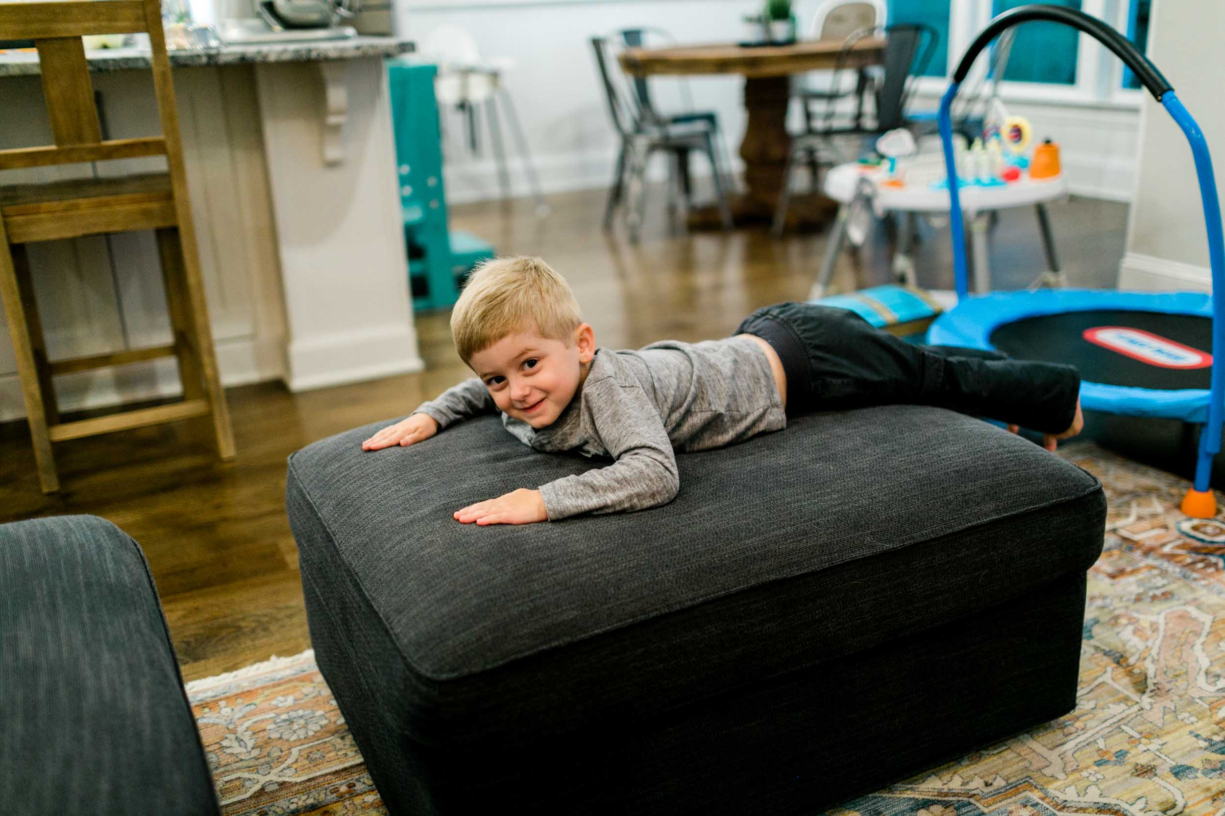 Boy smiling from couch | Durham Photographer | By G. Lin Photography
