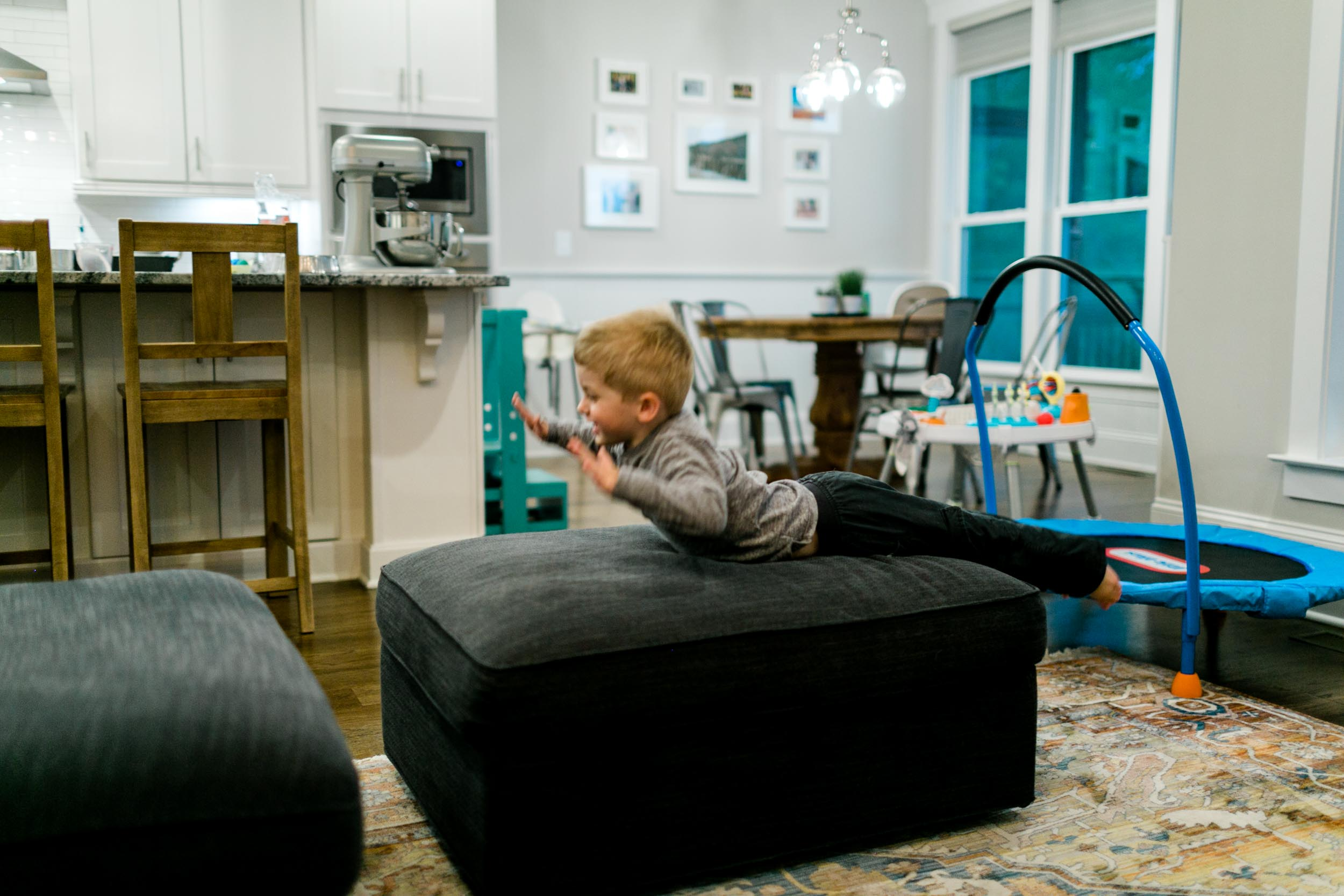 Little boy jumping on couch | Durham Photographer | Raleigh Lifestyle Family Photography | By G. Lin Photography