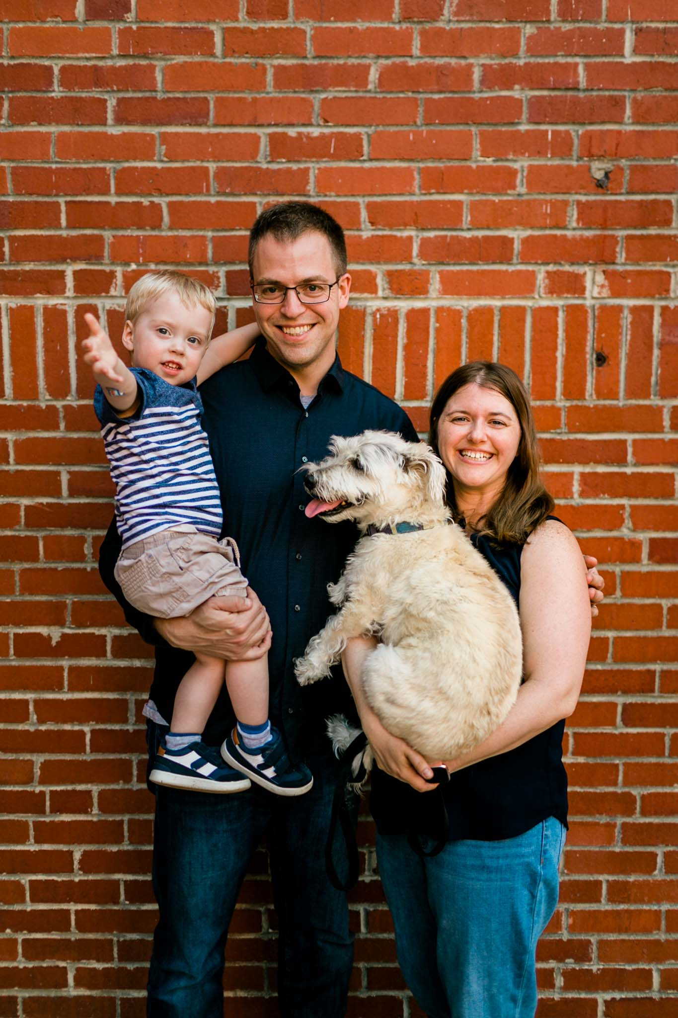 Candid family photo at American Tobacco Campus   Durham Family Photographer   By G. Lin Photography