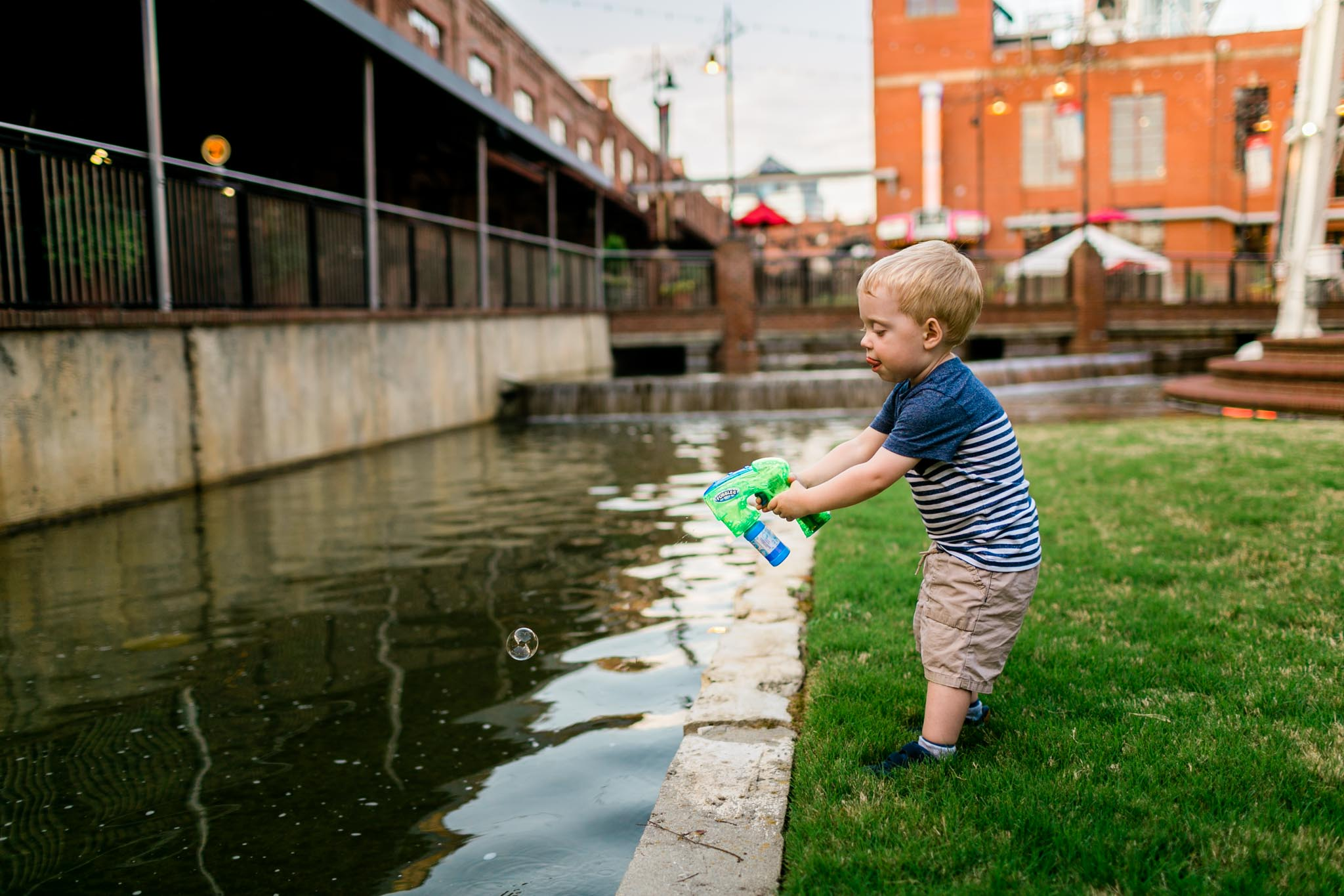 Durham Family and Children Photographer | Boy spraying bubbles | By G. Lin Photography