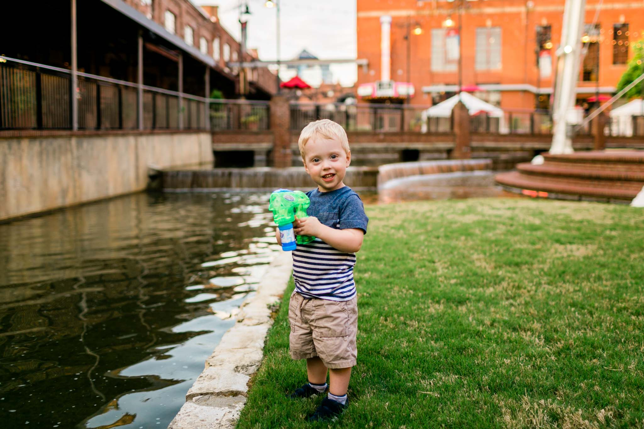 Boy smiling at camera | Durham Photographer | By G. Lin Photography