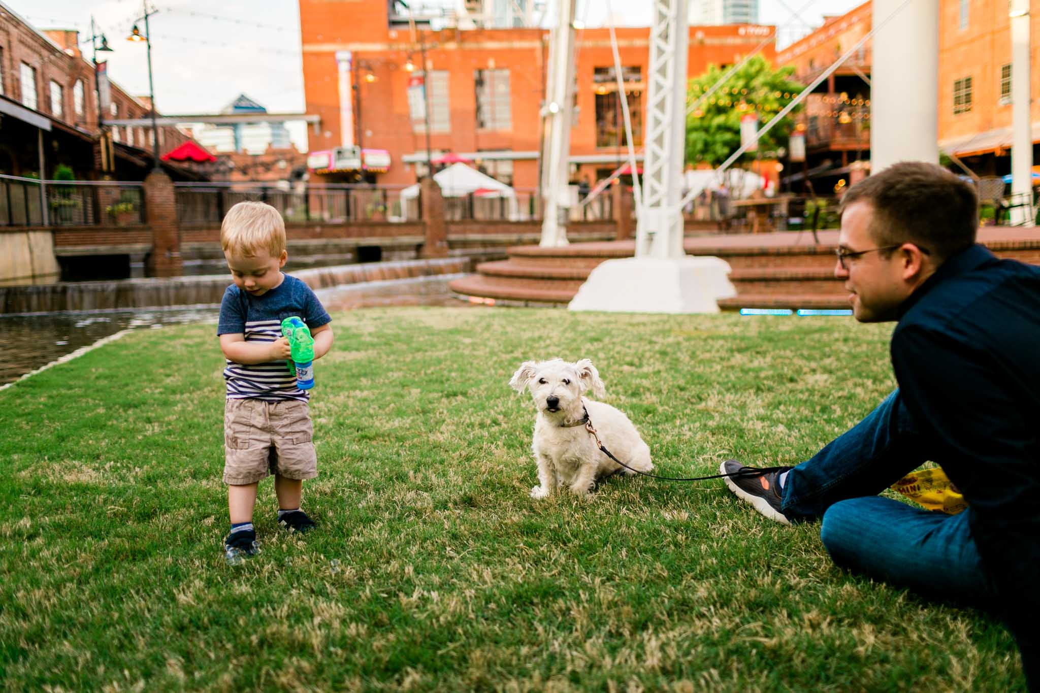 Candid lifestyle family photo at American Tobacco Campus | Durham Family Photographer | By G. Lin Photography