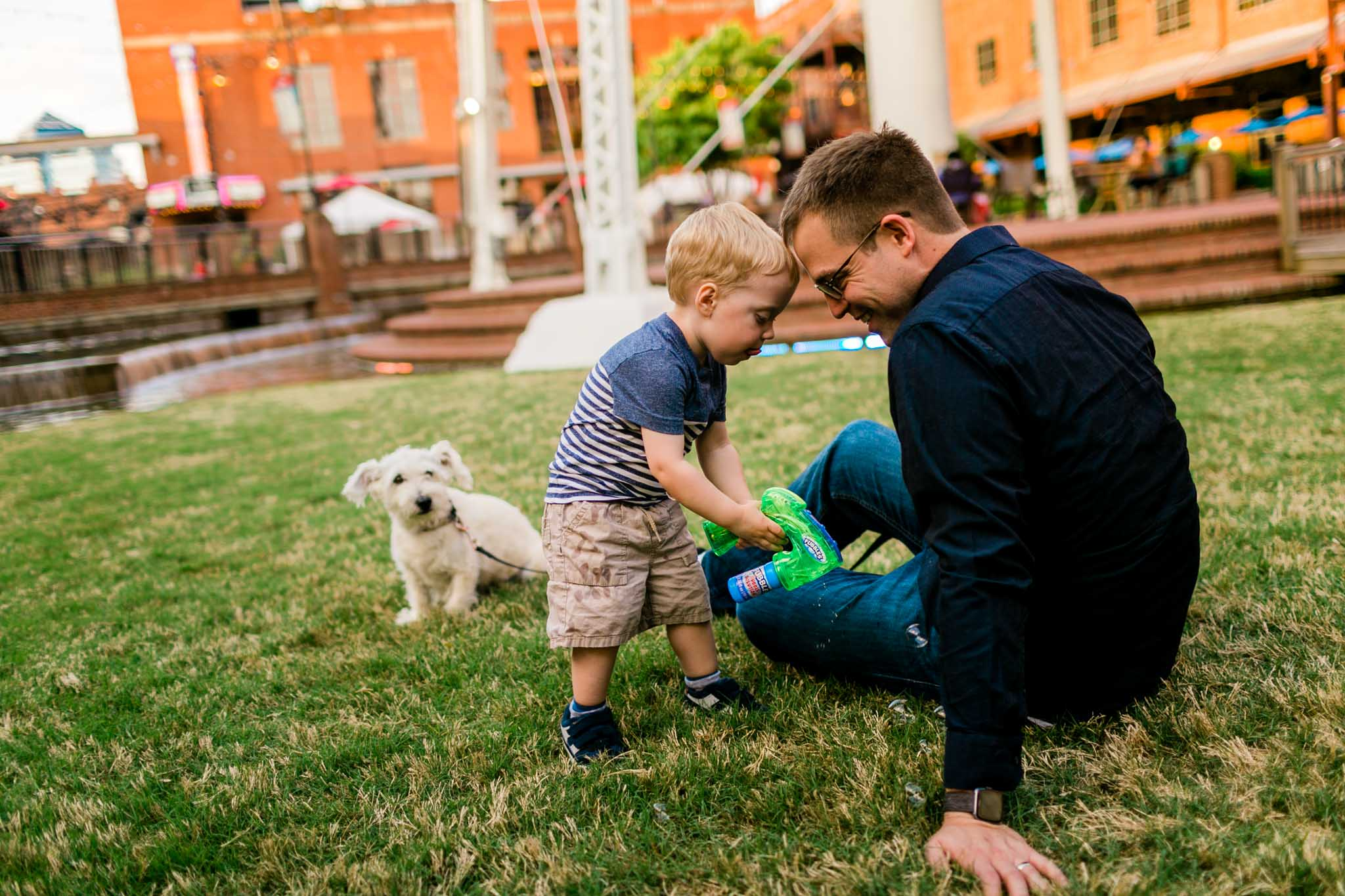 Candid photo of father and son | Durham Photographer | American Tobacco Campus | By G. Lin Photography
