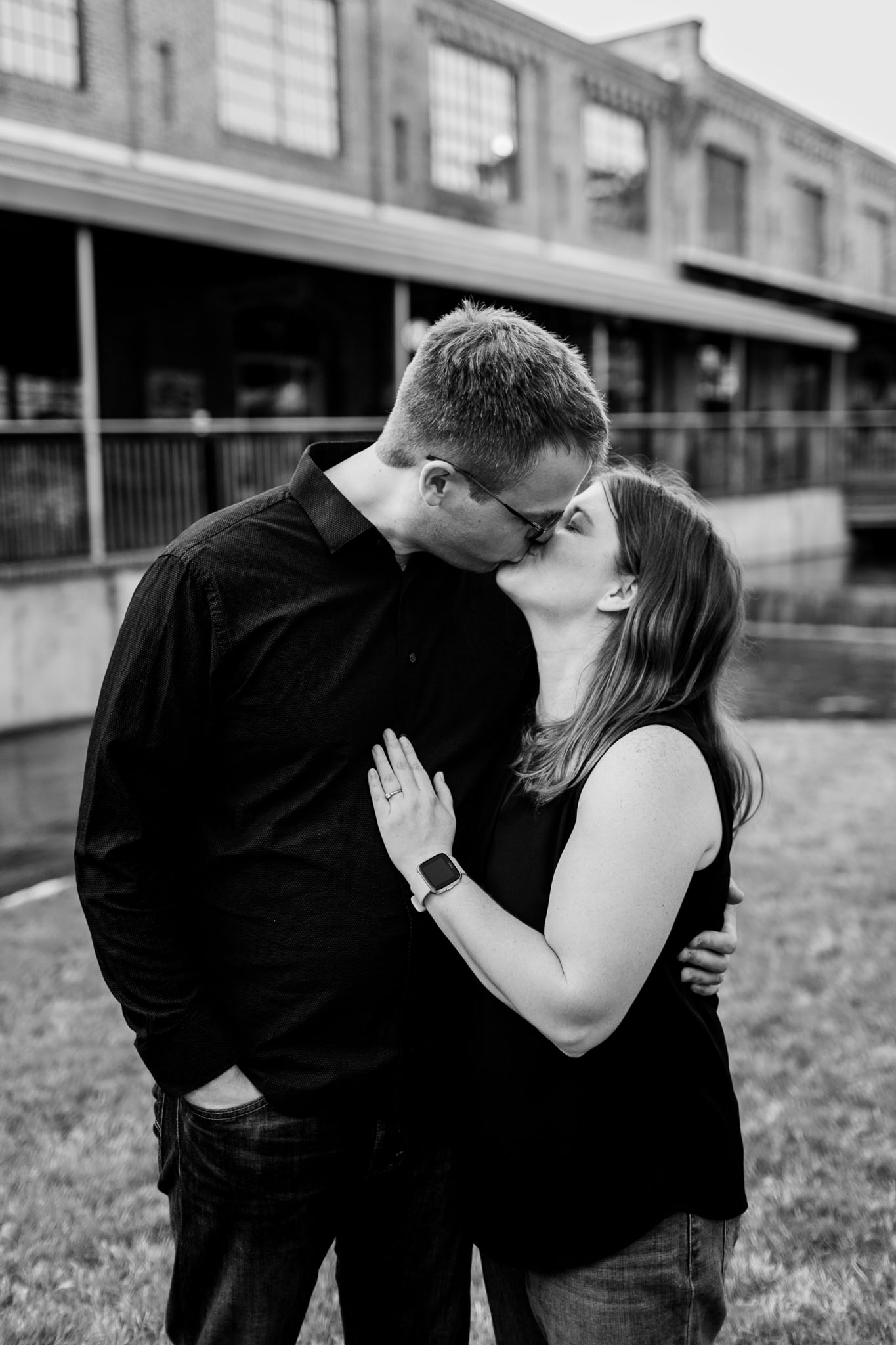 Durham Photographer | Black and white photo of couple kissing | American Tobacco Campus | By G. Lin Photography