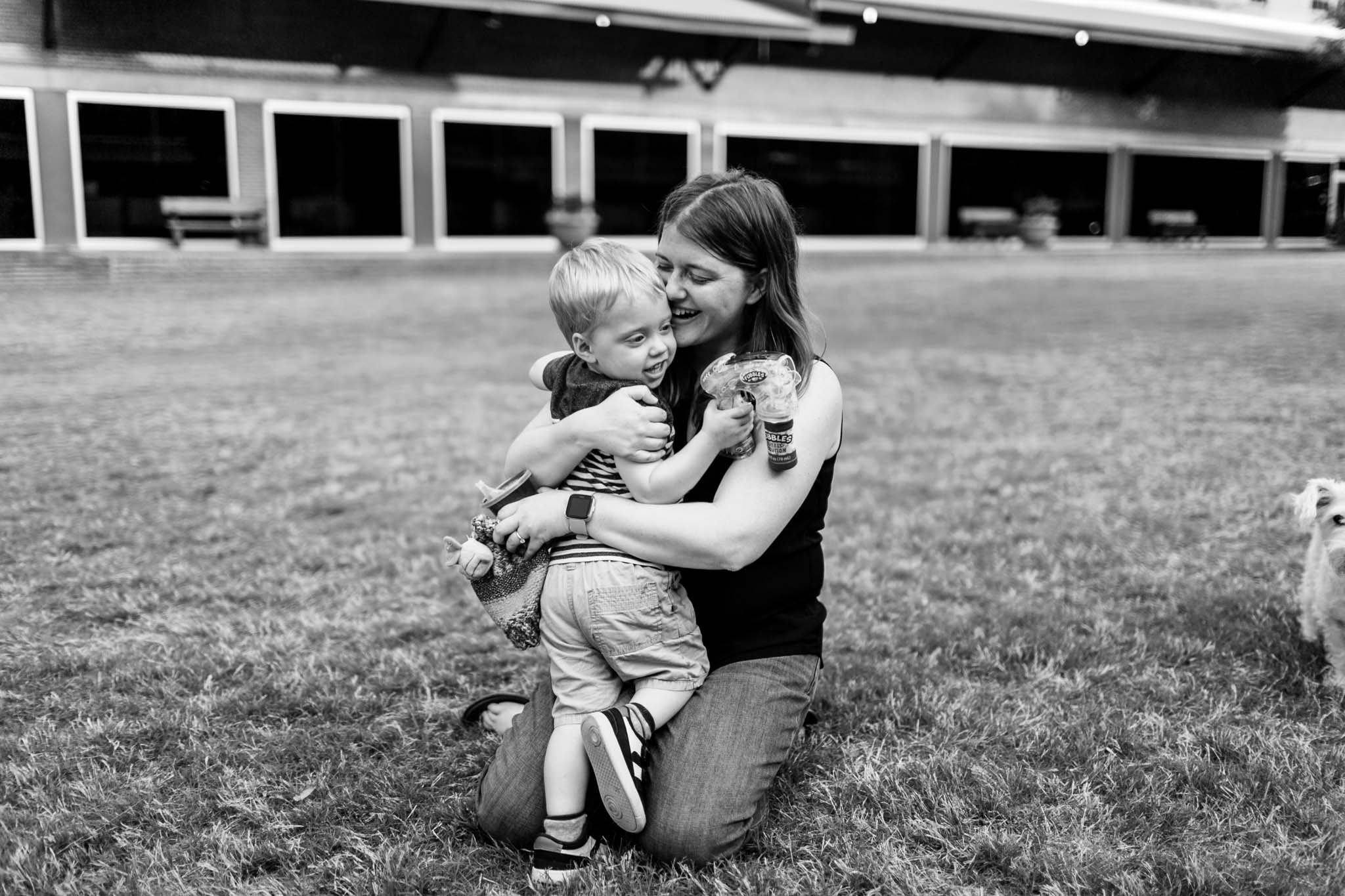 Black and white photo of mom and son hugging   Durham Photographer   By G. Lin Photography