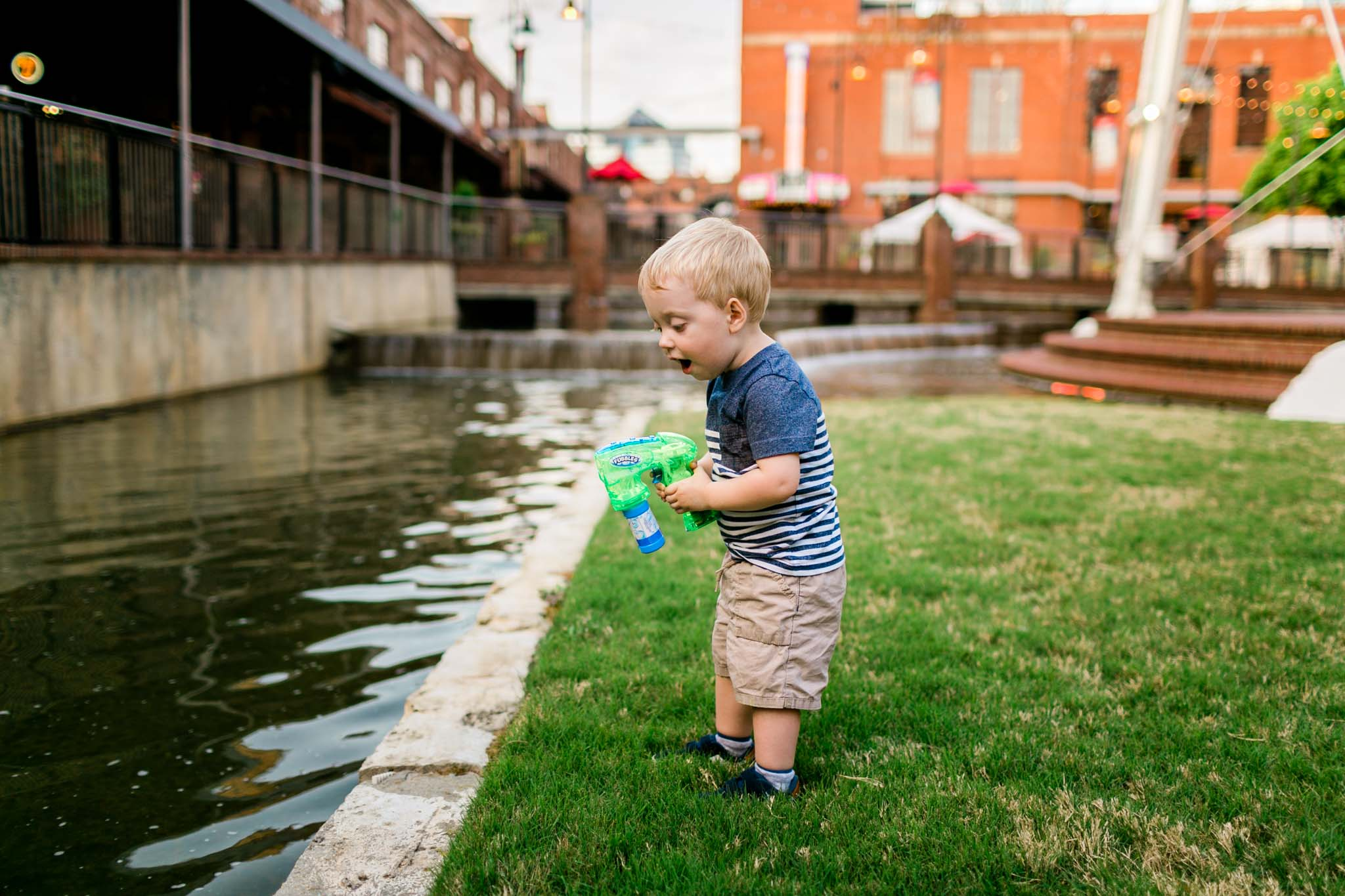 Boy playing with bubbles by water | Durham Photographer | By G. Lin Photography