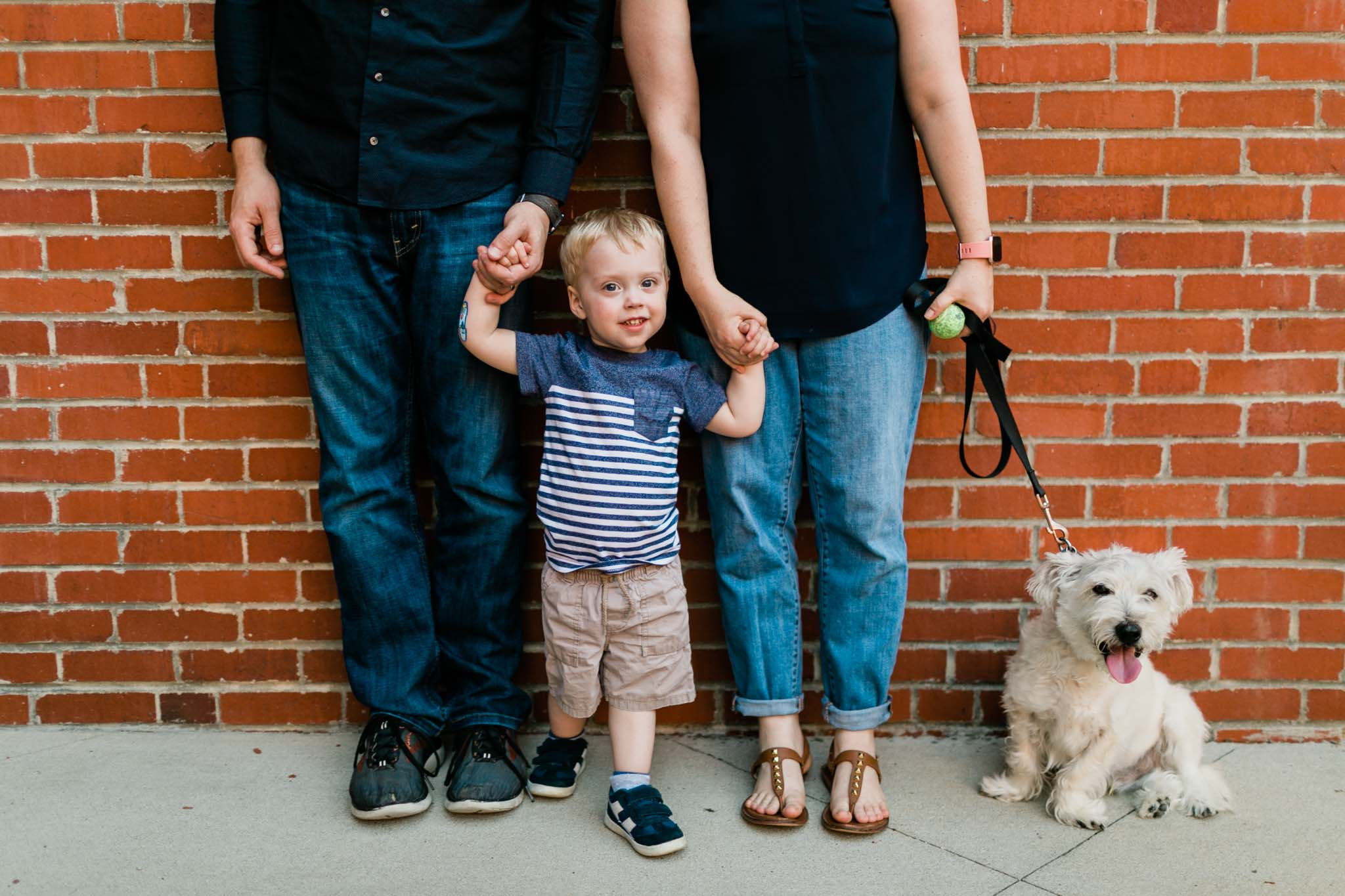 Boy holding hands with parents   Durham Family Photographer   By G. Lin Photography