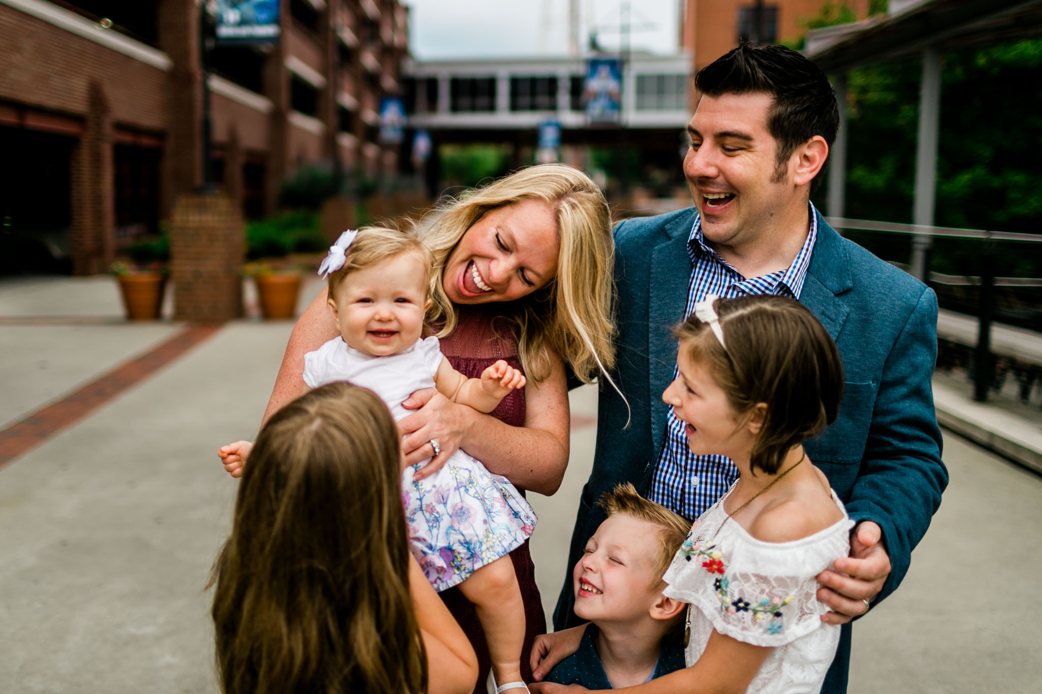 Durham Family Photographer | By G. Lin Photography | Family laughing outdoors together at American Tobacco Campus