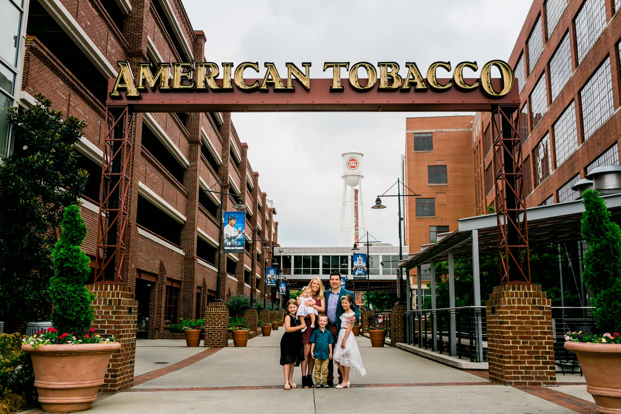 Durham Family Photographer | By G. Lin Photography | Family portrait next to American Tobacco Campus sign
