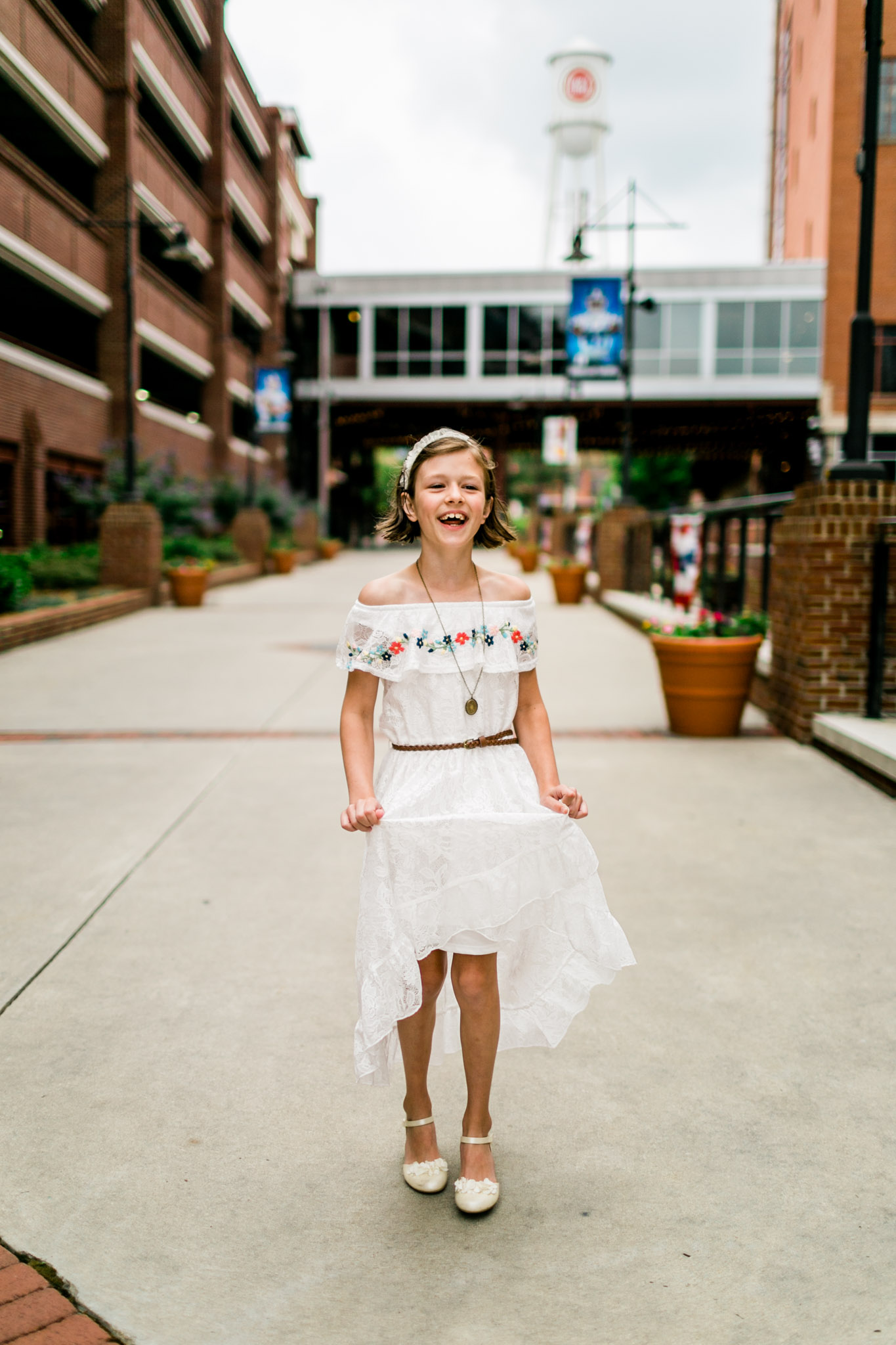 Durham Family Photographer | By G. Lin Photography | Portrait of girl twirling dress and laughing