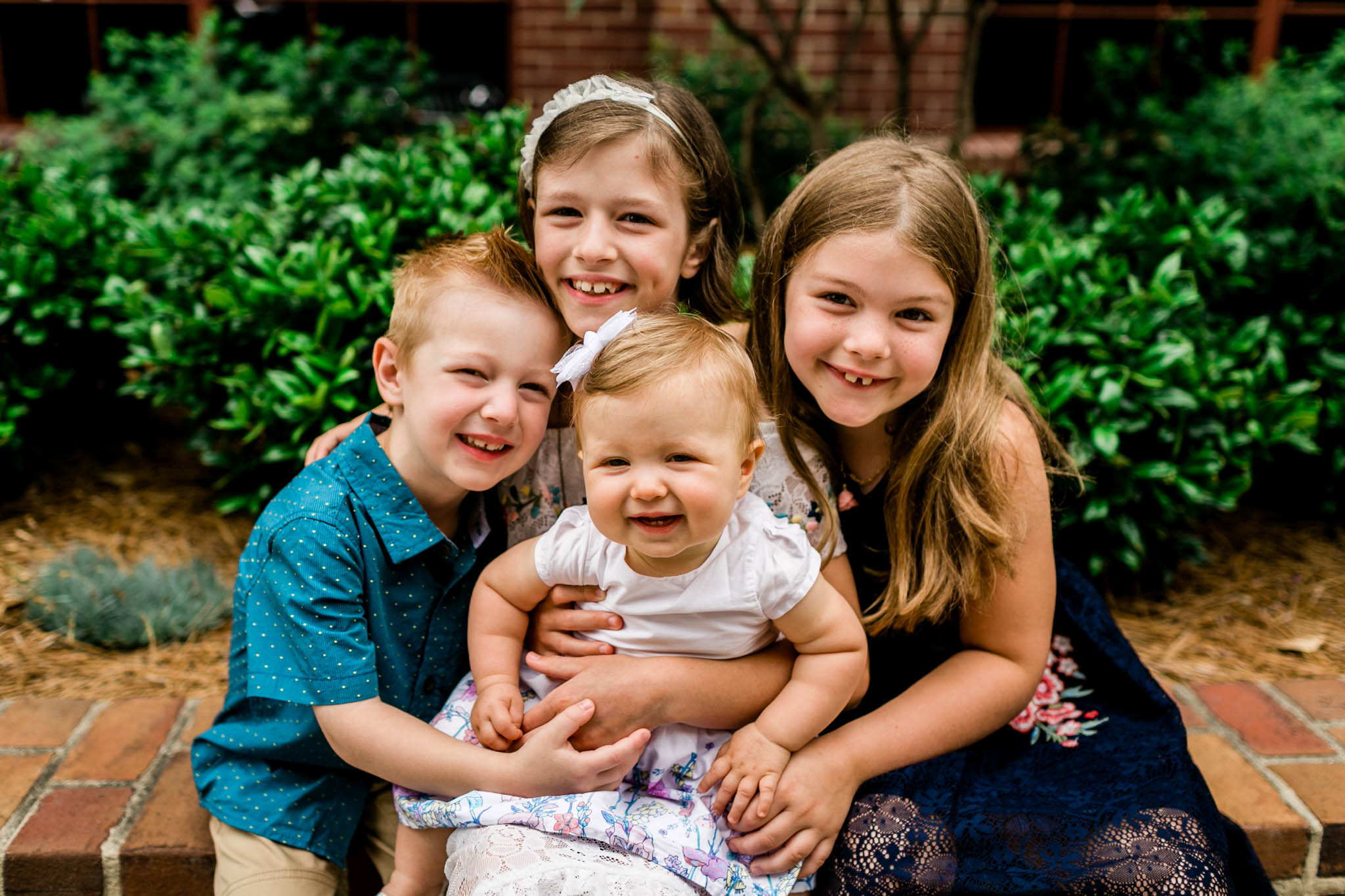 Durham Family Photographer | By G. Lin Photography | Beautiful sibling portrait outdoors at American Tobacco Campus