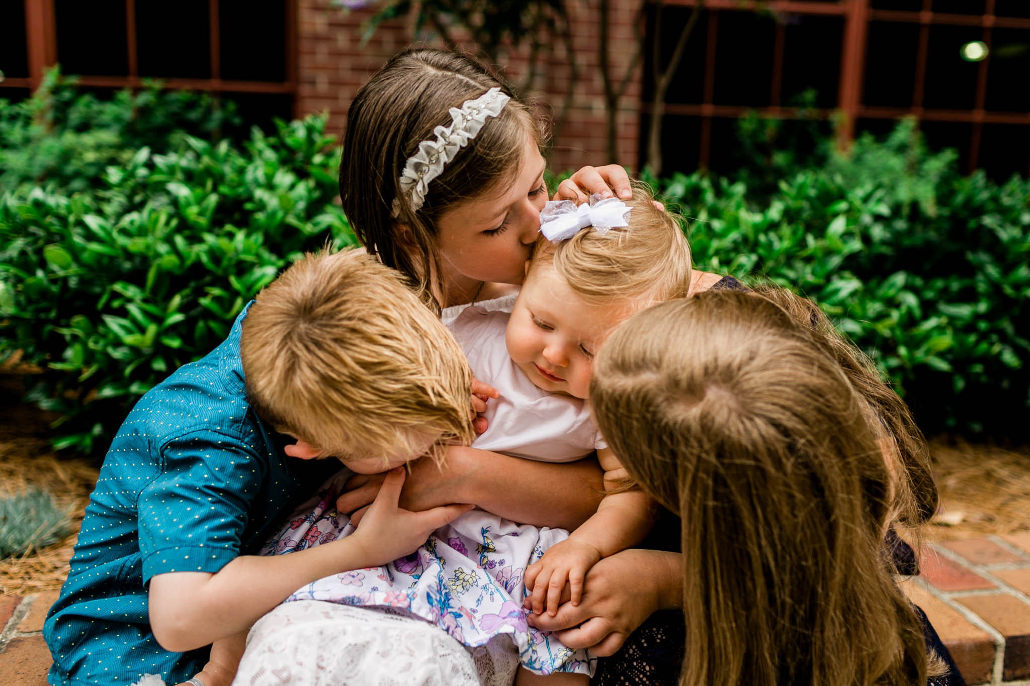 Durham Family Photographer | By G. Lin Photography | Candid sibling photo at American Tobacco Campus