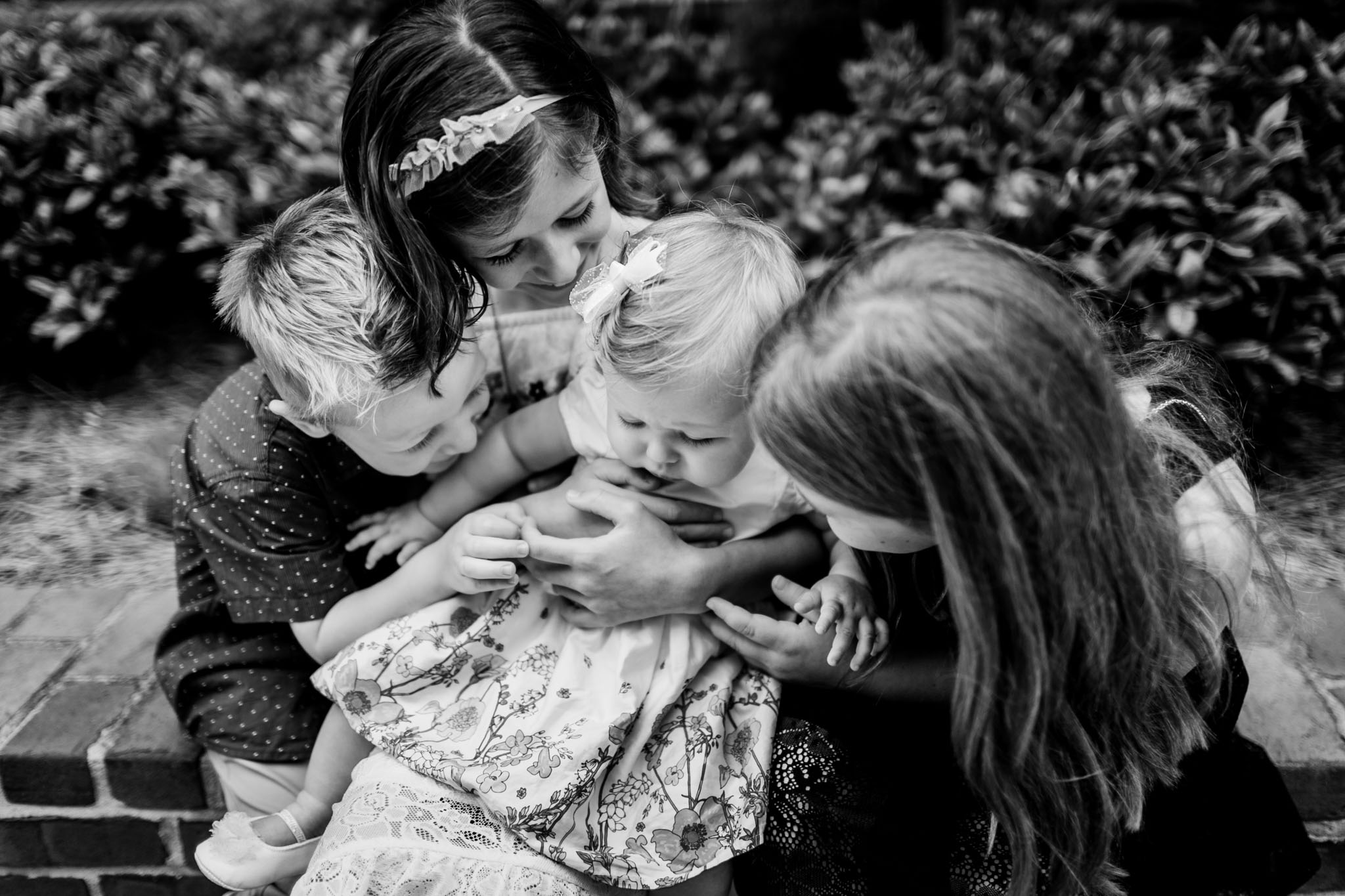 Durham Family Photographer | By G. Lin Photography | Black and white portrait of siblings holding baby sister