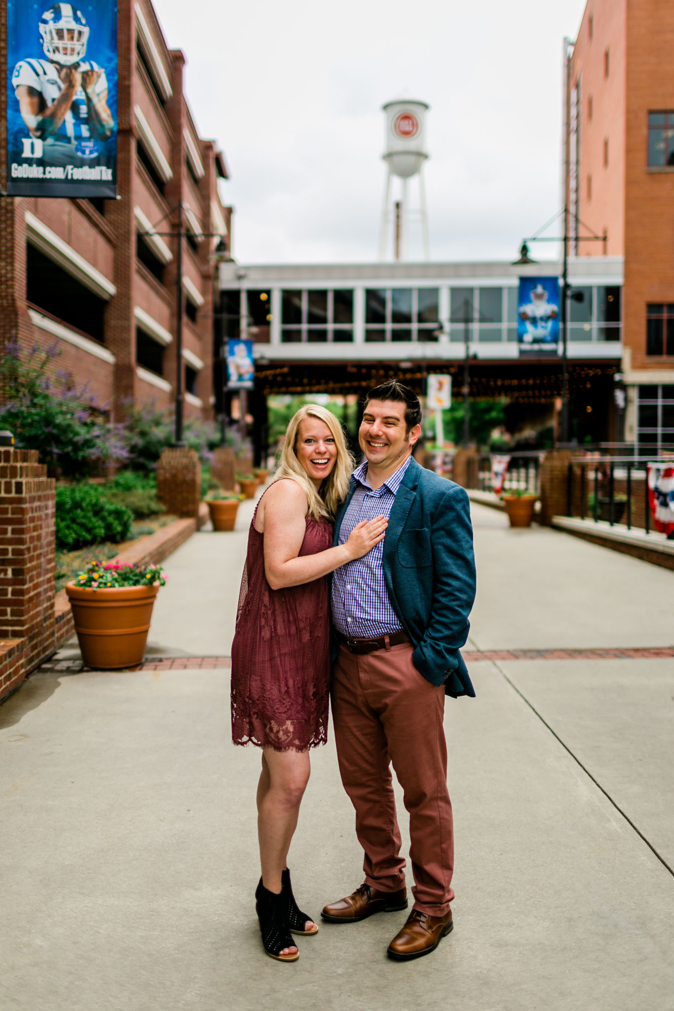 Durham Family Photographer | By G. Lin Photography | Portrait of couple smiling at camera at American Tobacco Campus