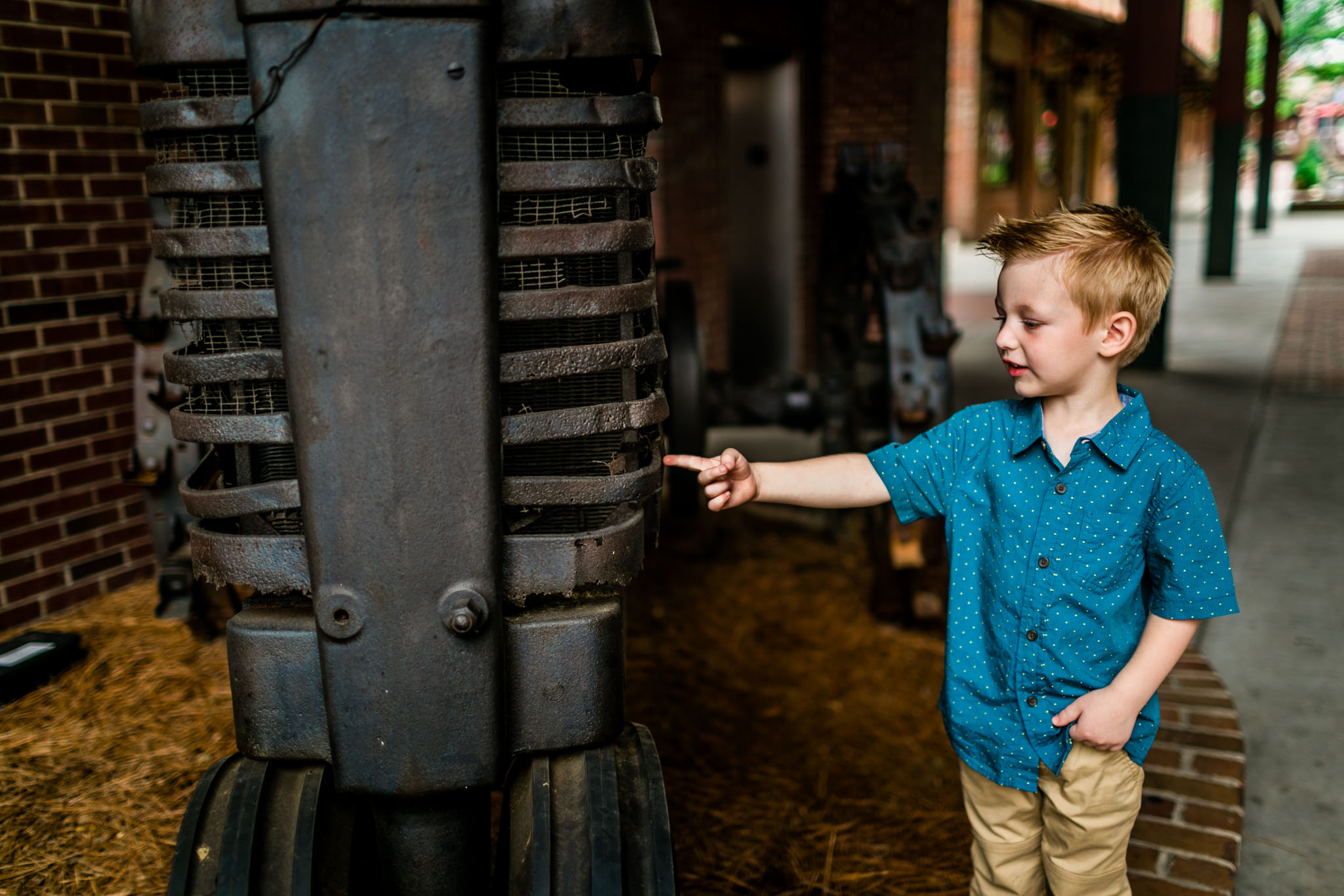 Durham Photographer | By G. Lin Photography | Young buy pointing at tractor