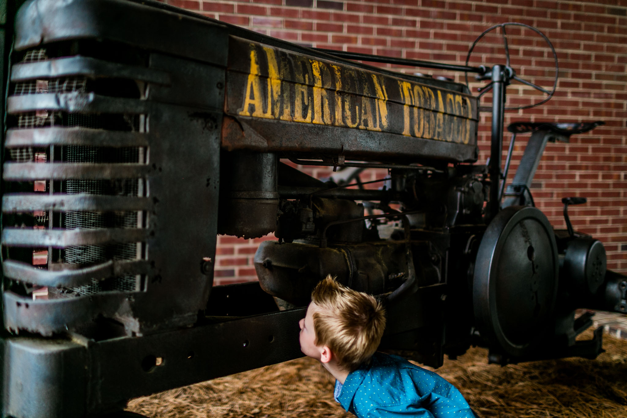 Durham Photographer | By G. Lin Photography | Young buy inspecting tractor