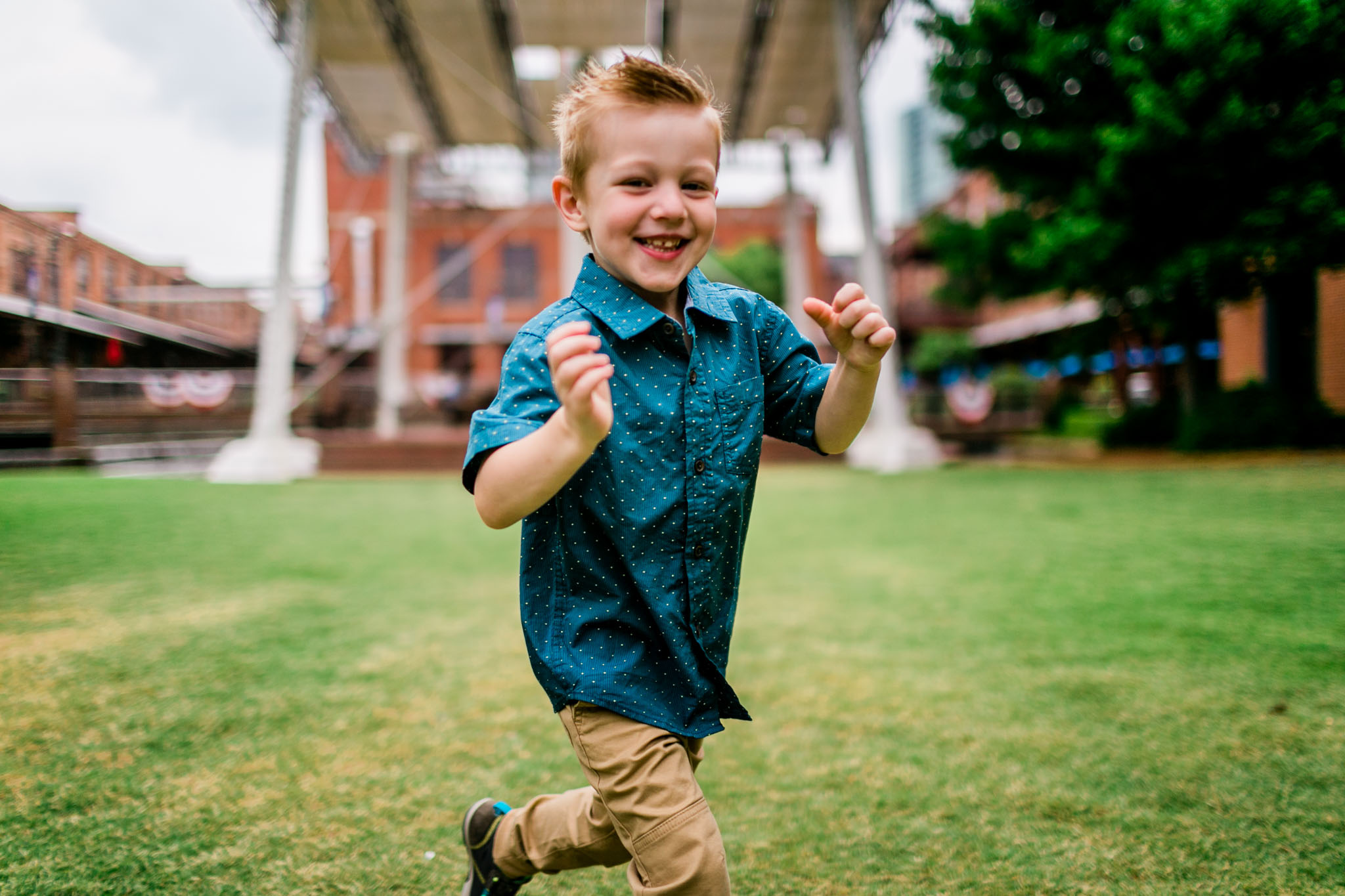 Durham Family Photographer | By G. Lin Photography | Candid photo of young boy running across grass and laughing