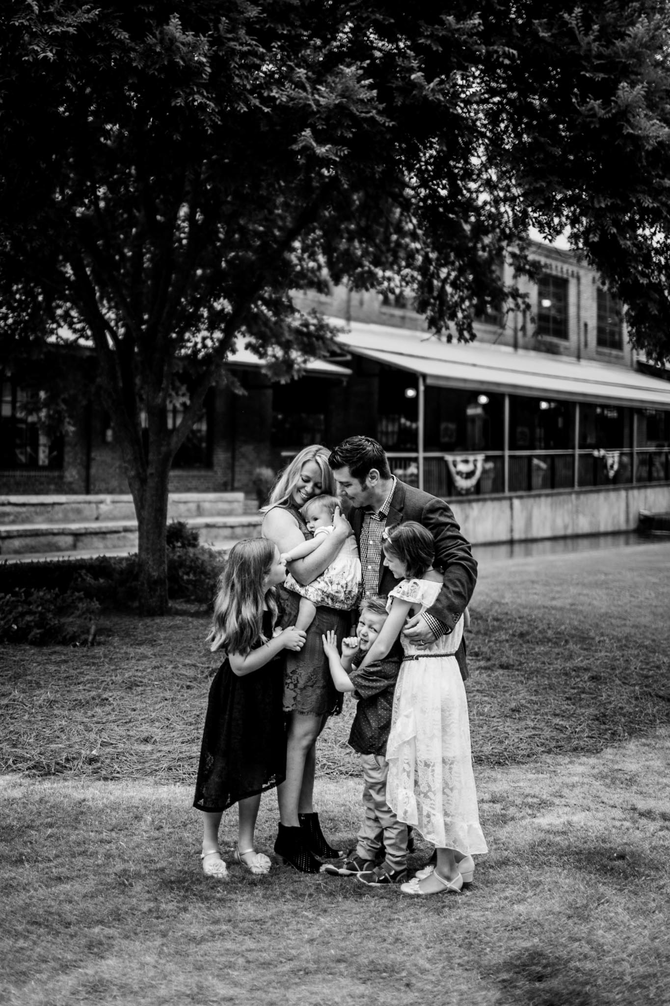 Durham Family Photographer | By G. Lin Photography | Candid black and white portrait of family hugging together