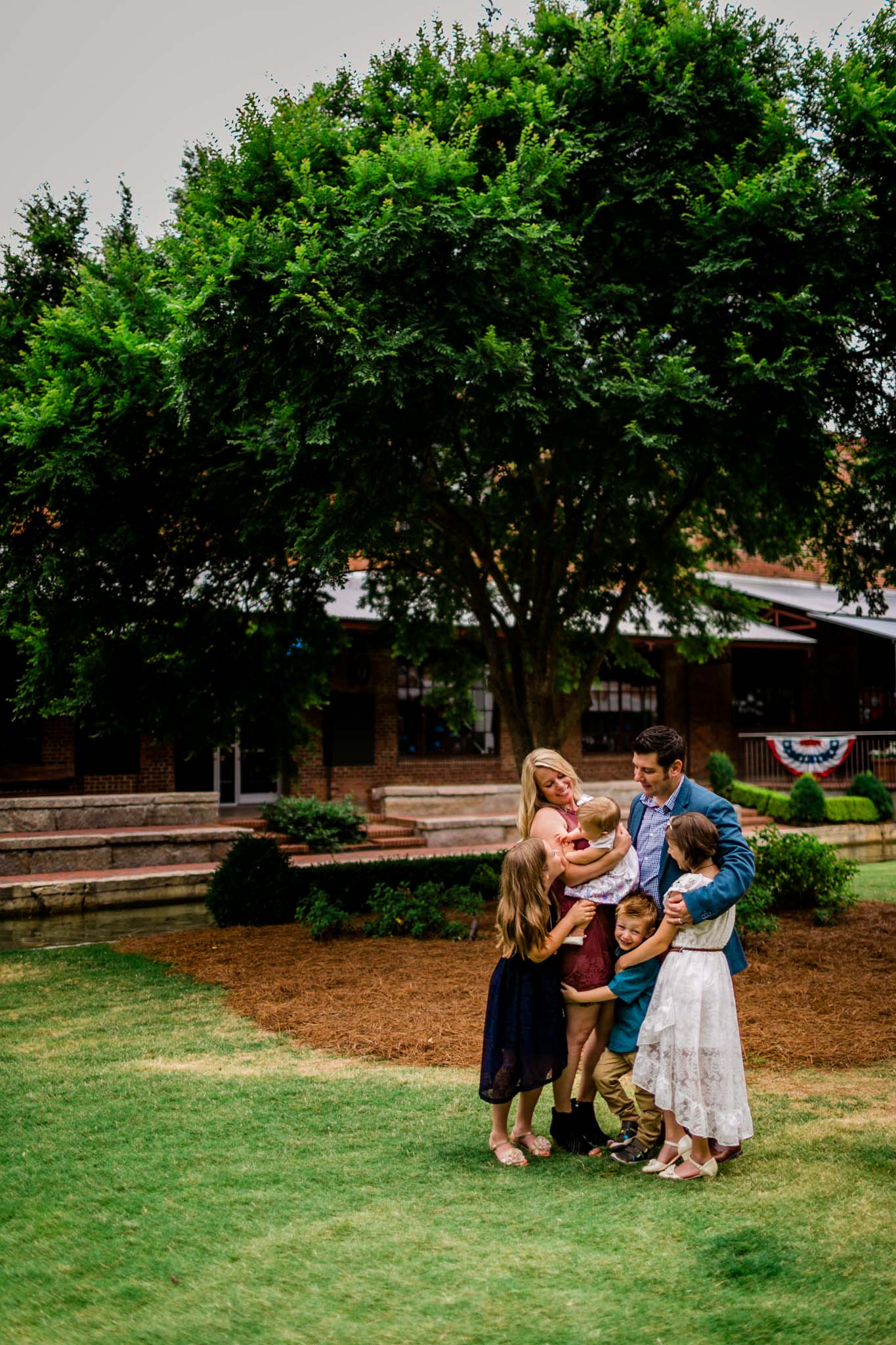Durham Family Photographer | By G. Lin Photography | Candid portrait of family hugging together
