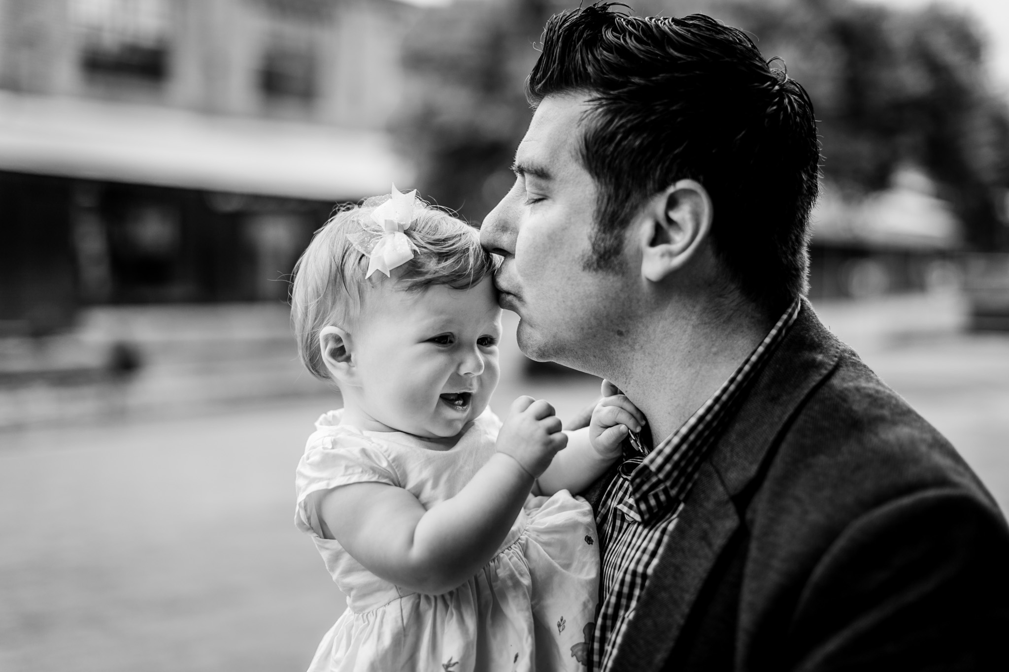 Durham Family Photographer | By G. Lin Photography | Father kissing baby girl on head