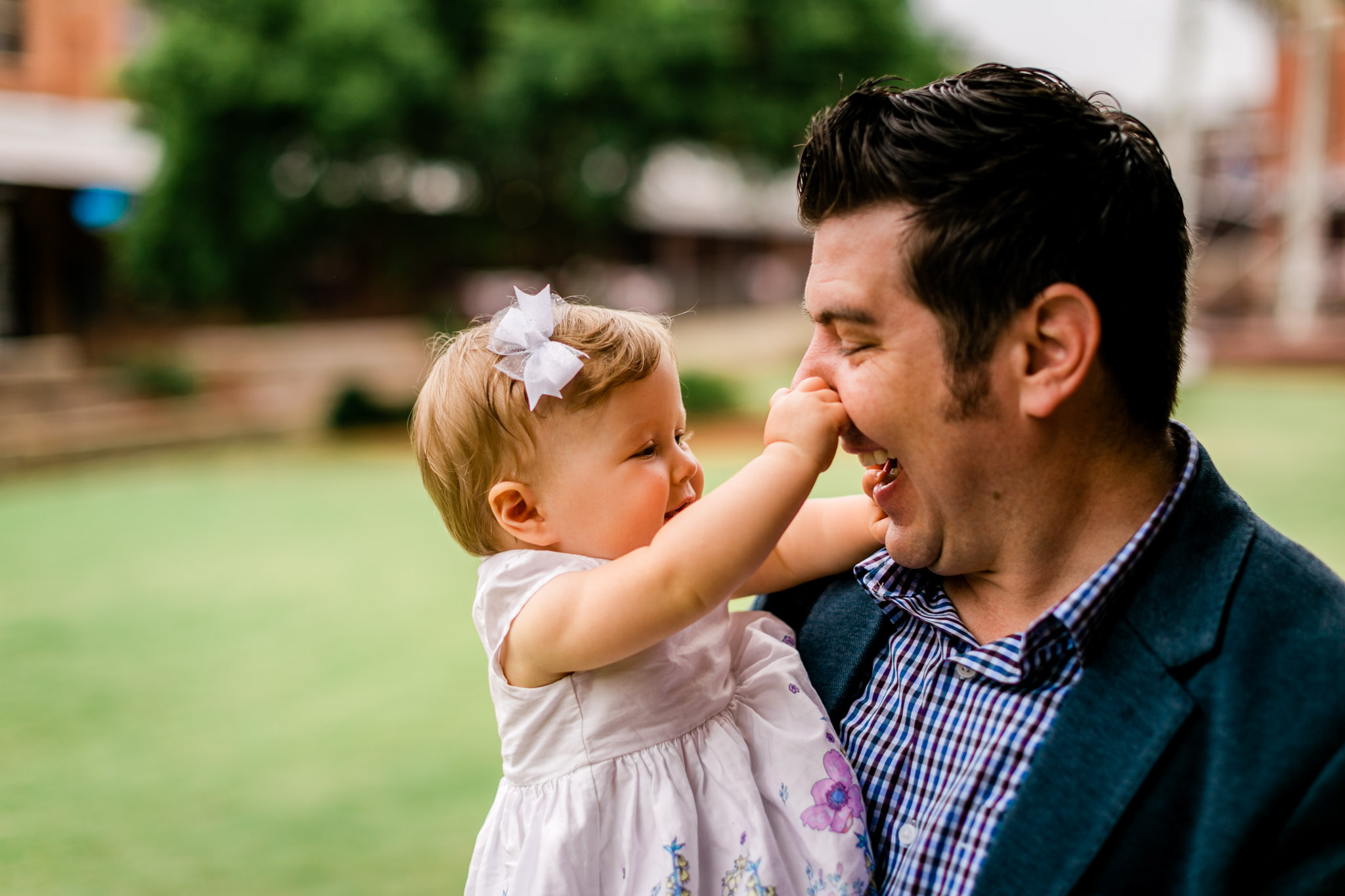 Durham Family Photographer | By G. Lin Photography | Baby girl pulling on dad's nose