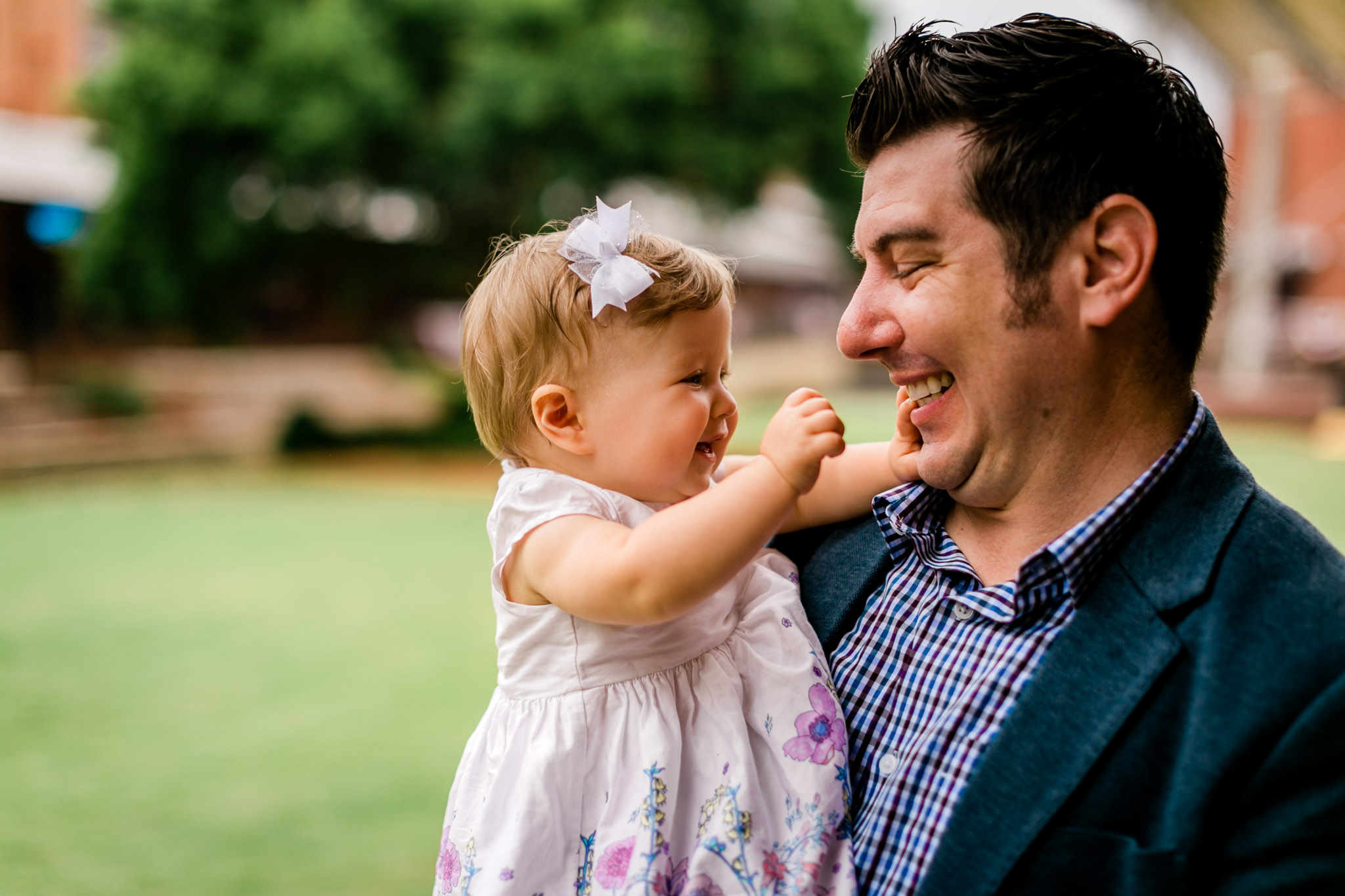 Durham Family Photographer | By G. Lin Photography | father and baby daughter playing with each other