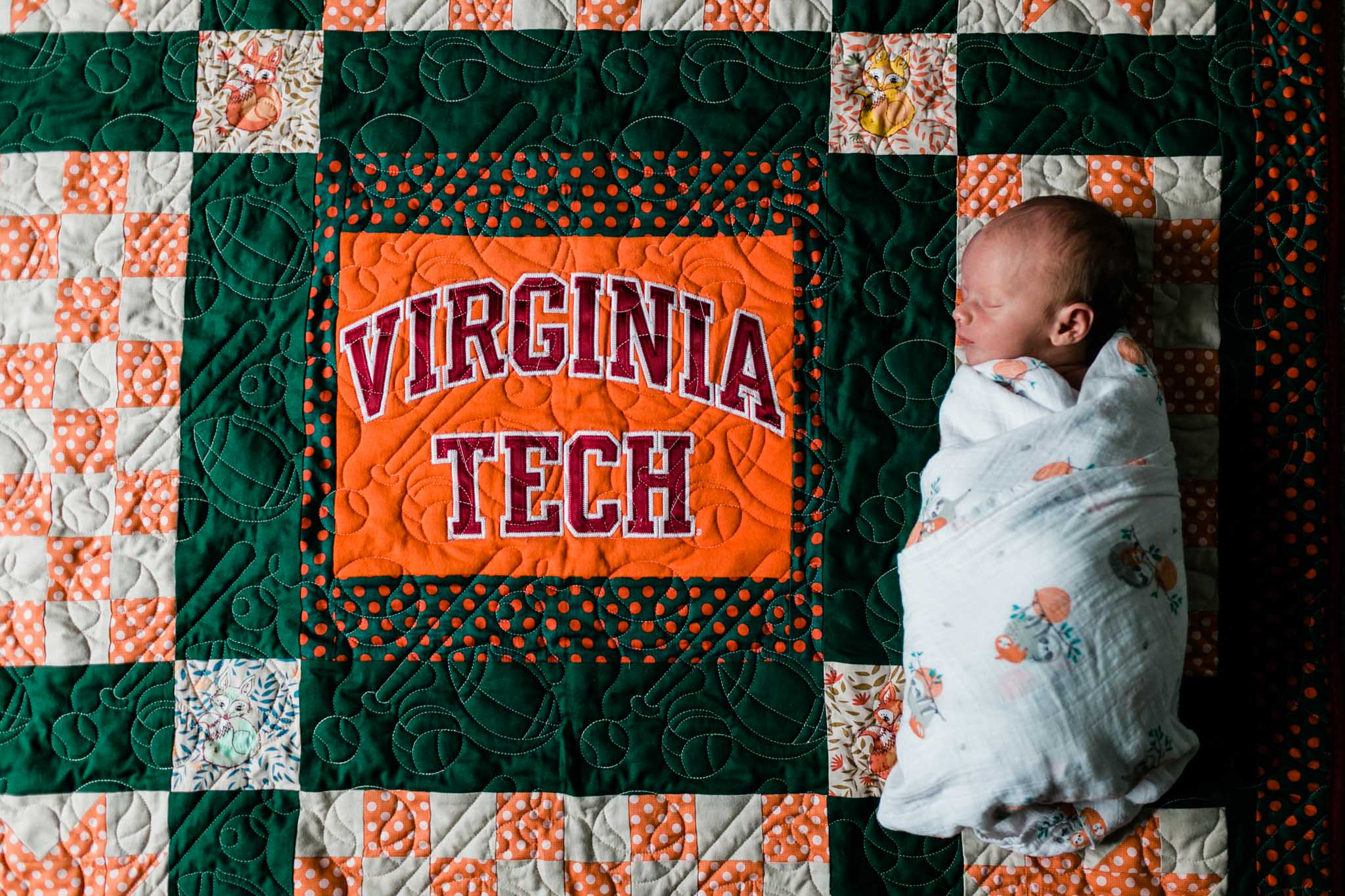Durham Newborn Photographer | By G. Lin Photography | Baby lying on Virginia Tech blanket quilt
