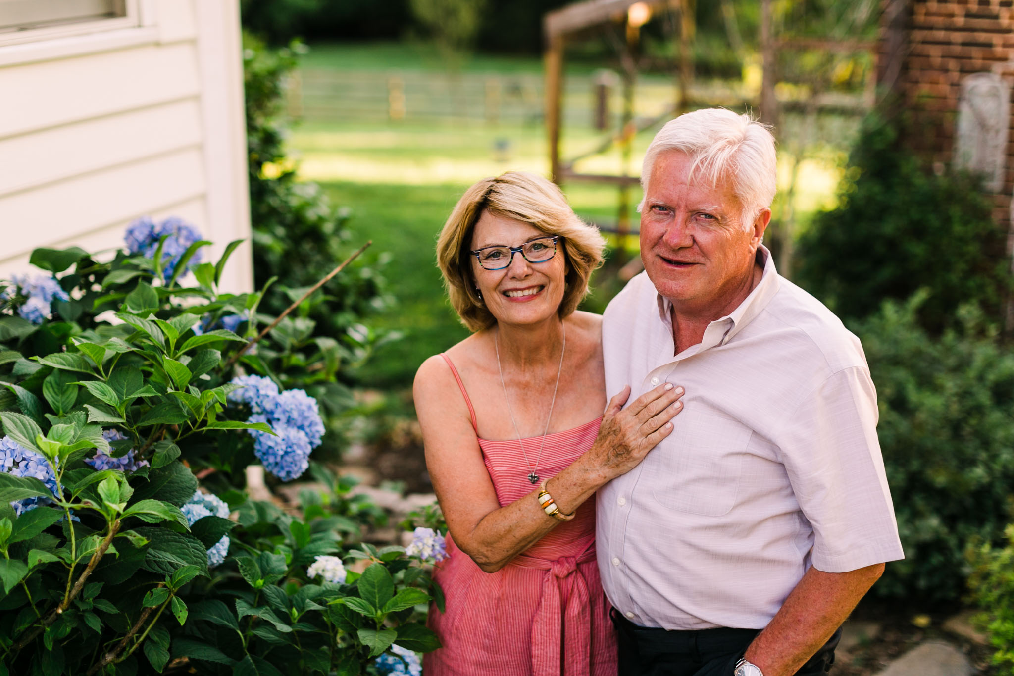 Durham Family Photographer | By G. Lin Photography | Portrait of grandparents smiling at camera outside