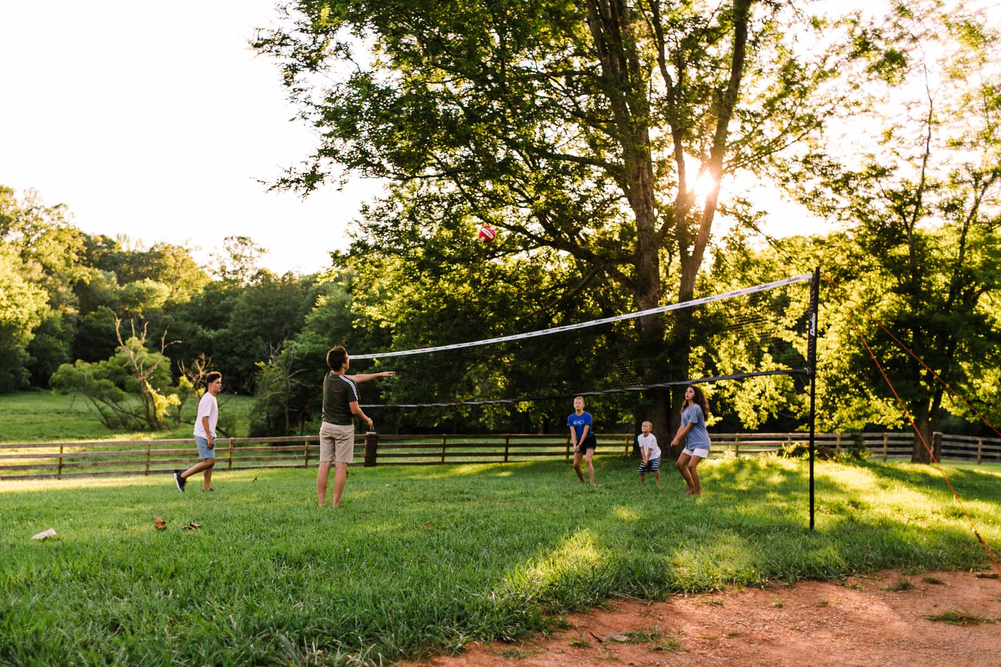 Durham Family Photographer | By G. Lin Photography | Teenage kids playing volleyball outdoors
