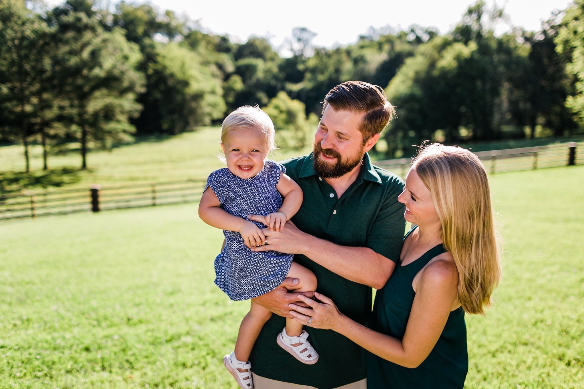Durham Family Photographer | By G. Lin Photography | Mom and dad holding baby girl outside