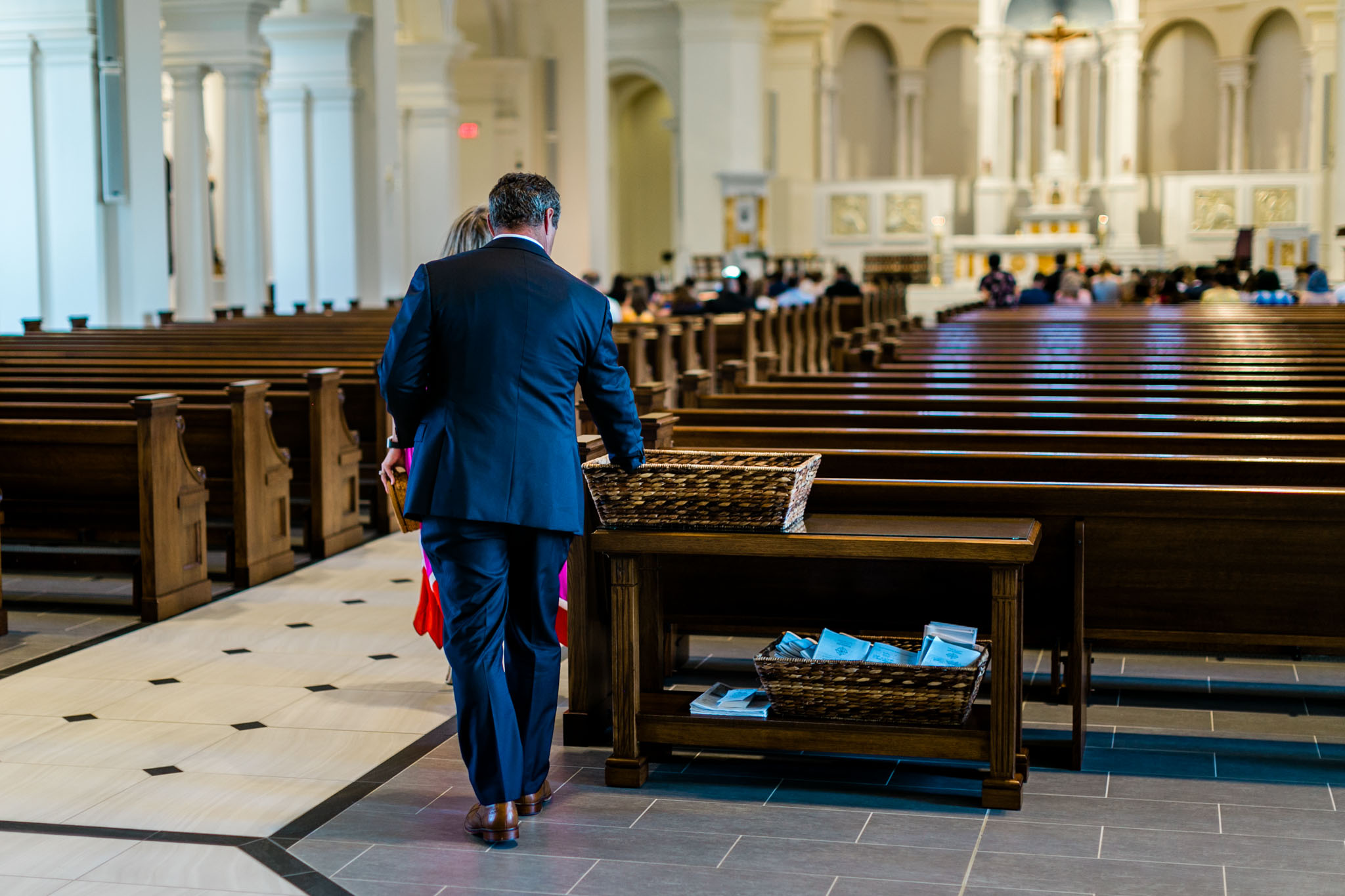 Man picking up wedding program |  Raleigh Wedding Photographer | By G. Lin Photography