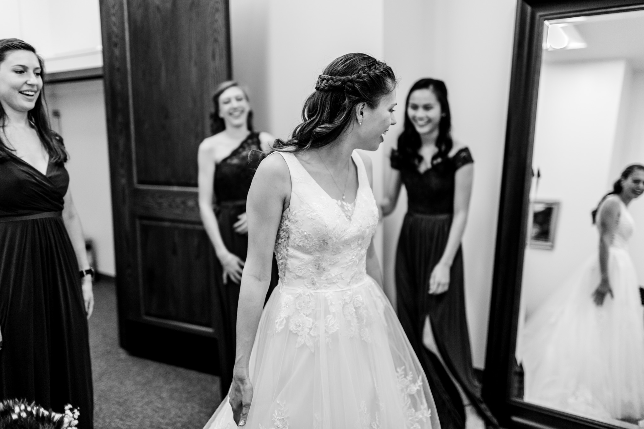 Black and white photo of bride looking in mirror | Durham Wedding Photographer | By G. Lin Photography