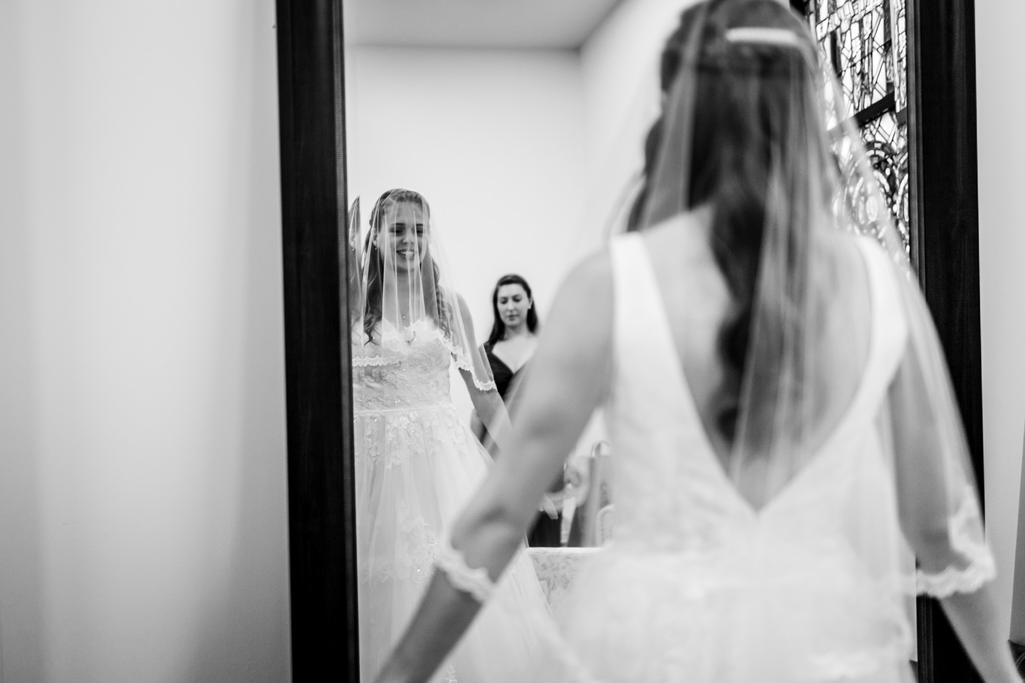 Beautiful black and white photo of bride looking at mirror | Raleigh Wedding Photographer | By G. Lin Photography