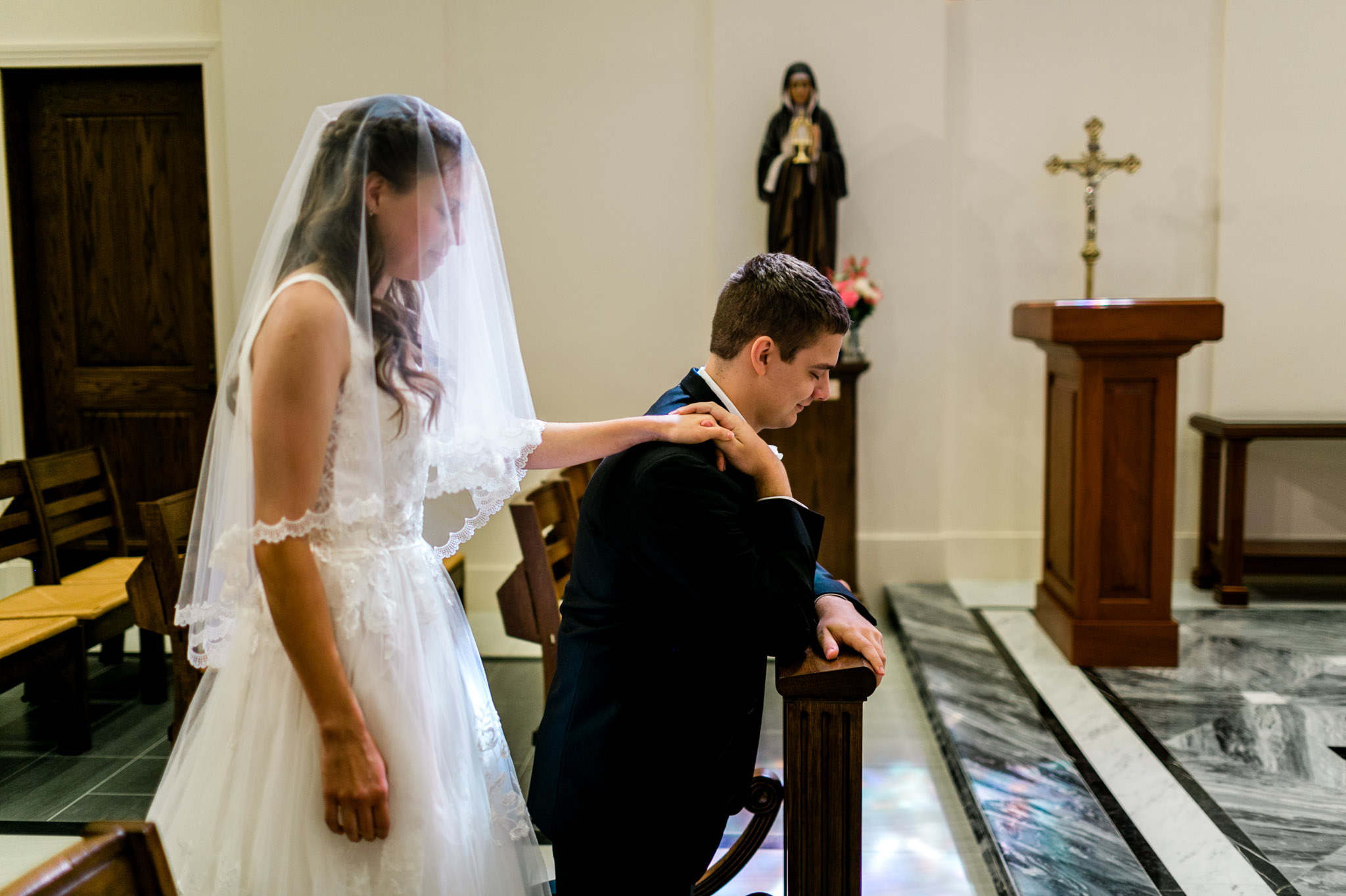 Bride and Groom praying in chapel at Holy Name of Jesus Cathedral | Raleigh Wedding Photographer | By G. Lin Photography