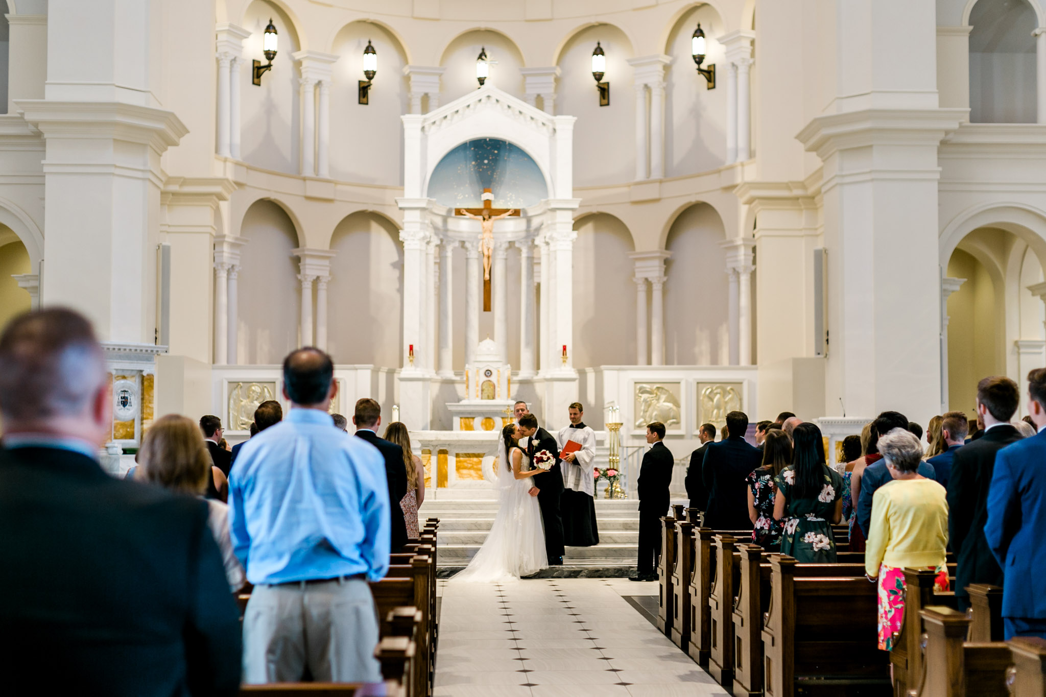 Bride and groom kiss | Holy Name of Jesus Cathedral | Raleigh Wedding Photographer | By G. Lin Photography