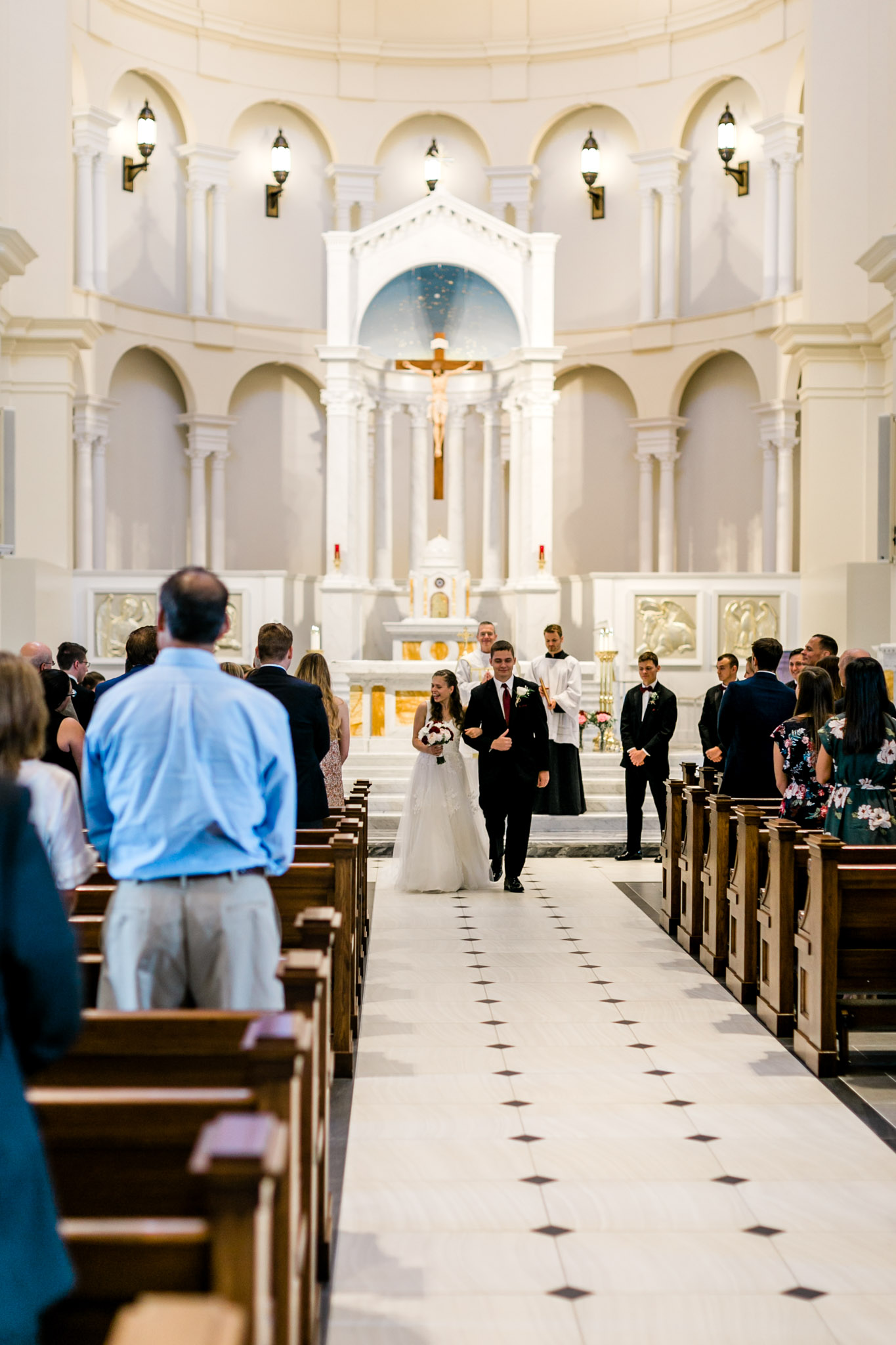 Bride and groom walking down the aisle | Holy Name of Jesus Cathedral | Raleigh Wedding Photographer | By G. Lin Photography