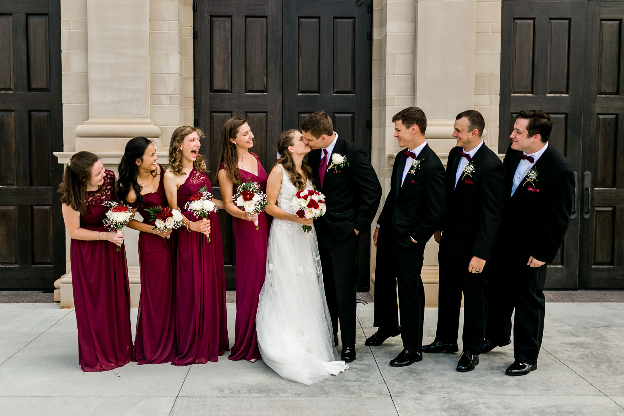 Wedding party photo with bride and groom kissing | Raleigh Wedding Photographer | By G. Lin Photography