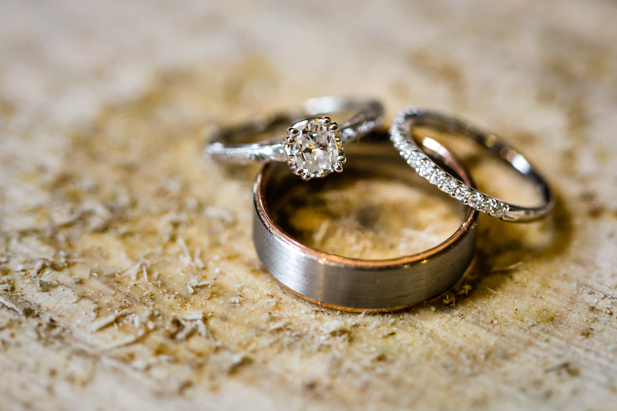 Wedding bands sitting on piece of wood | Durham Wedding Photographer | By G. Lin Photography