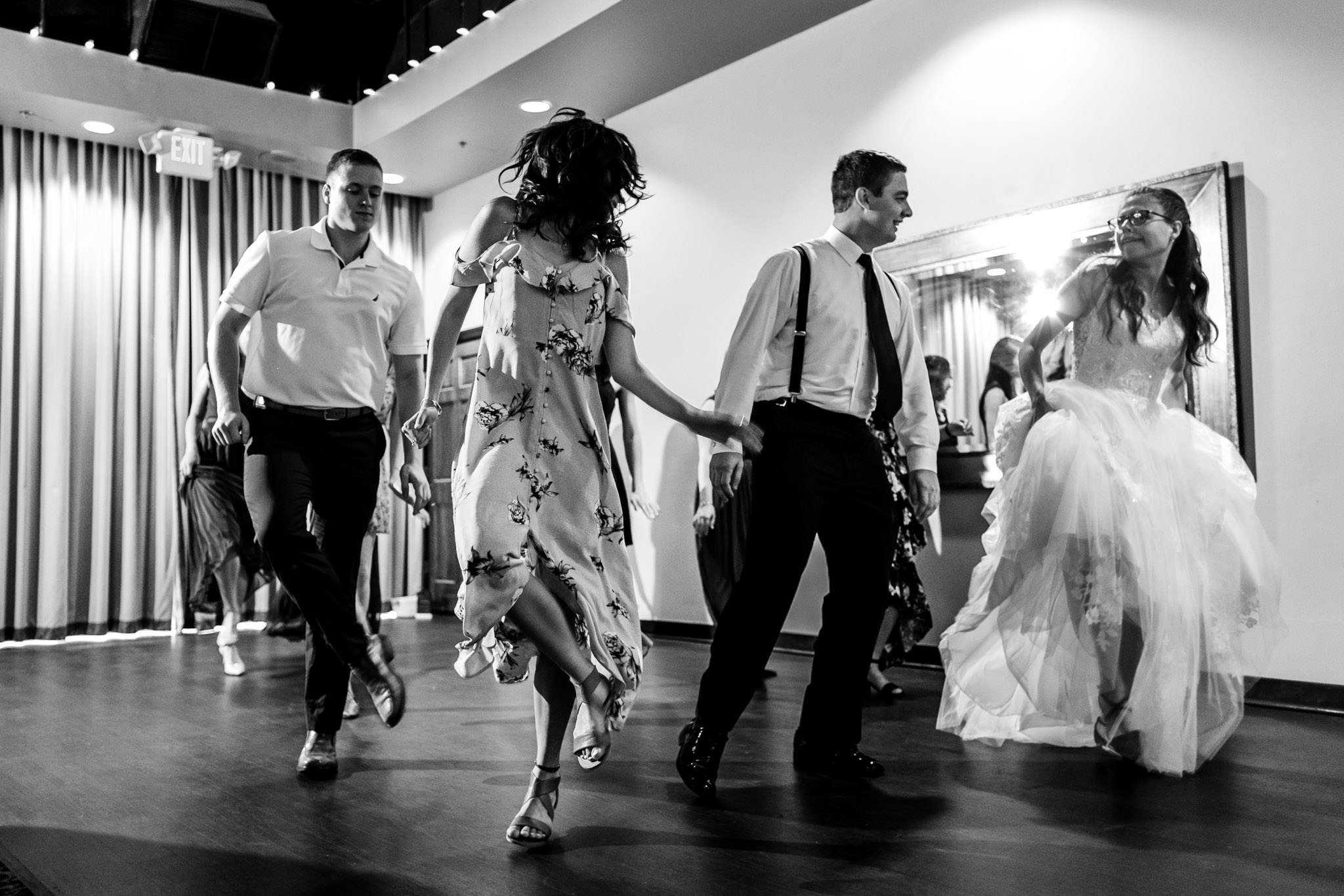 Black and white photo of people dancing at wedding reception at Royal Banquet Conference Center | Raleigh Wedding Photographer | By G. Lin Photography