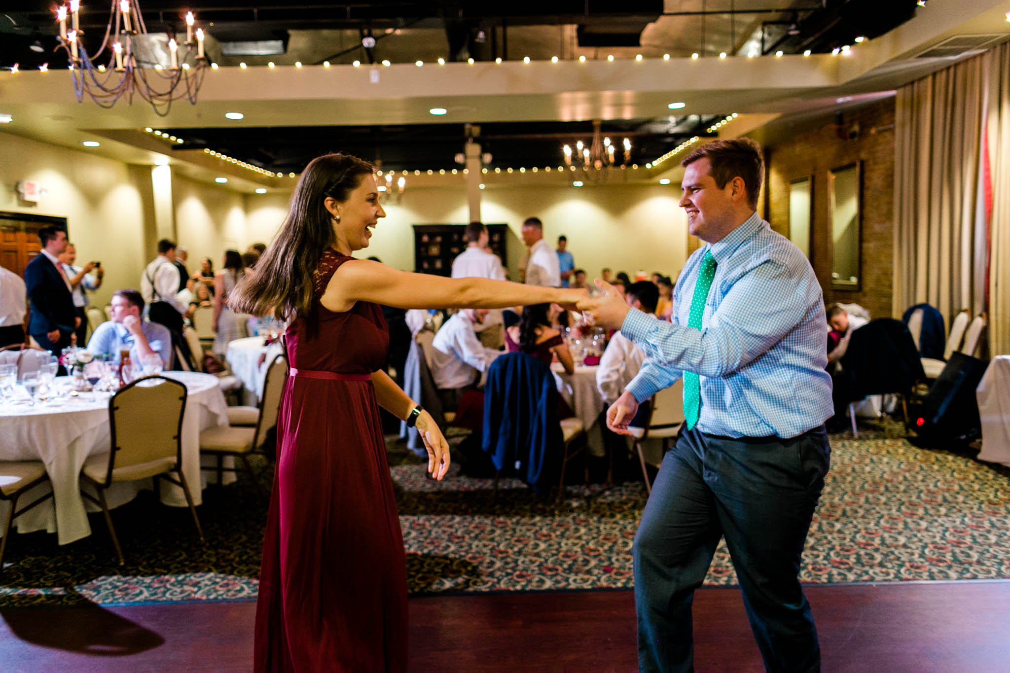 Man and woman dancing | Royal Banquet Hall |People dancing at wedding reception at Royal Banquet Conference Center | Raleigh Wedding Photographer | By G. Lin Photography