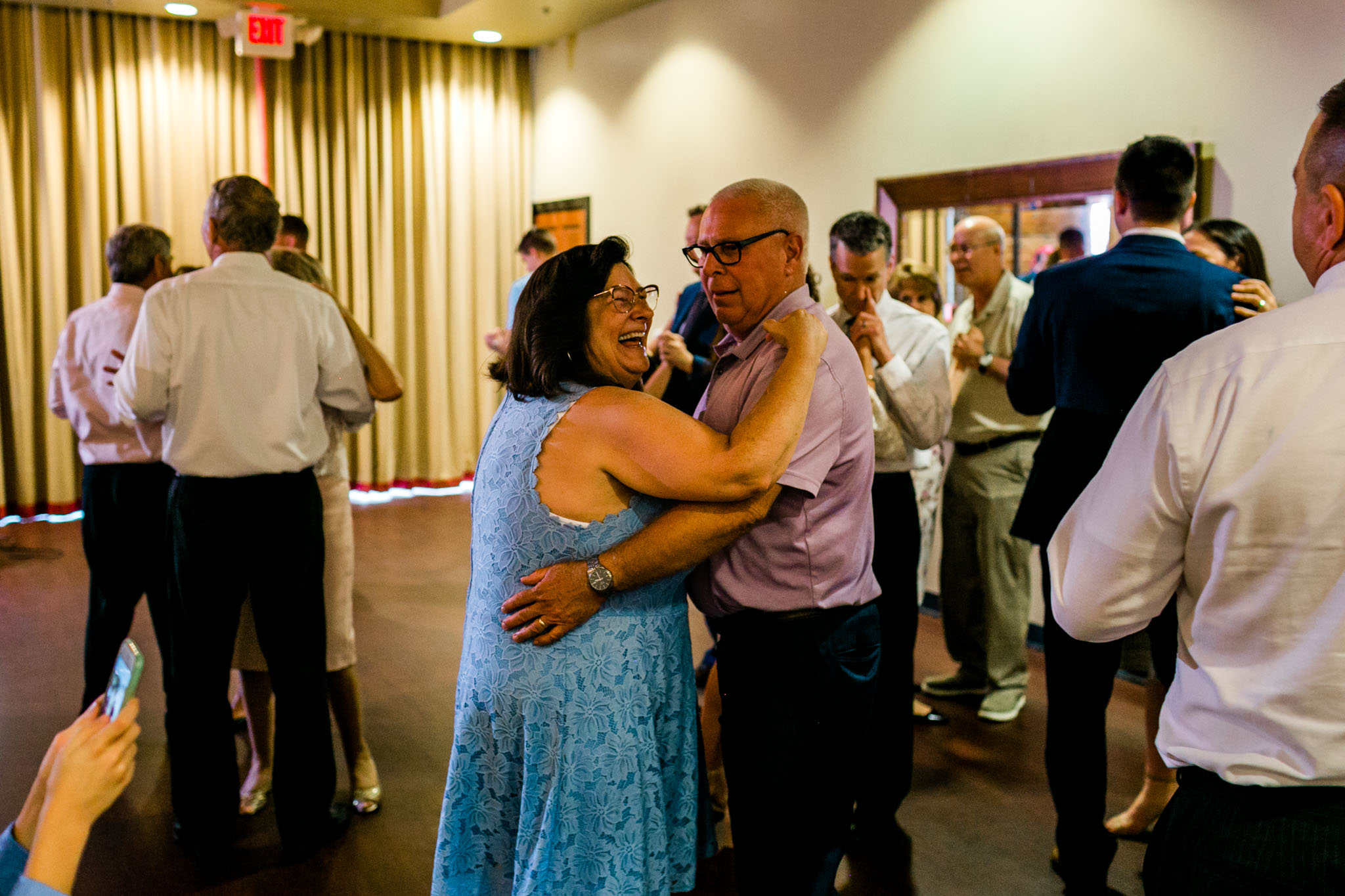 Man and woman dancing at reception | Royal Banquet Conference Center |People dancing at wedding reception at Royal Banquet Conference Center | Raleigh Wedding Photographer | By G. Lin Photography