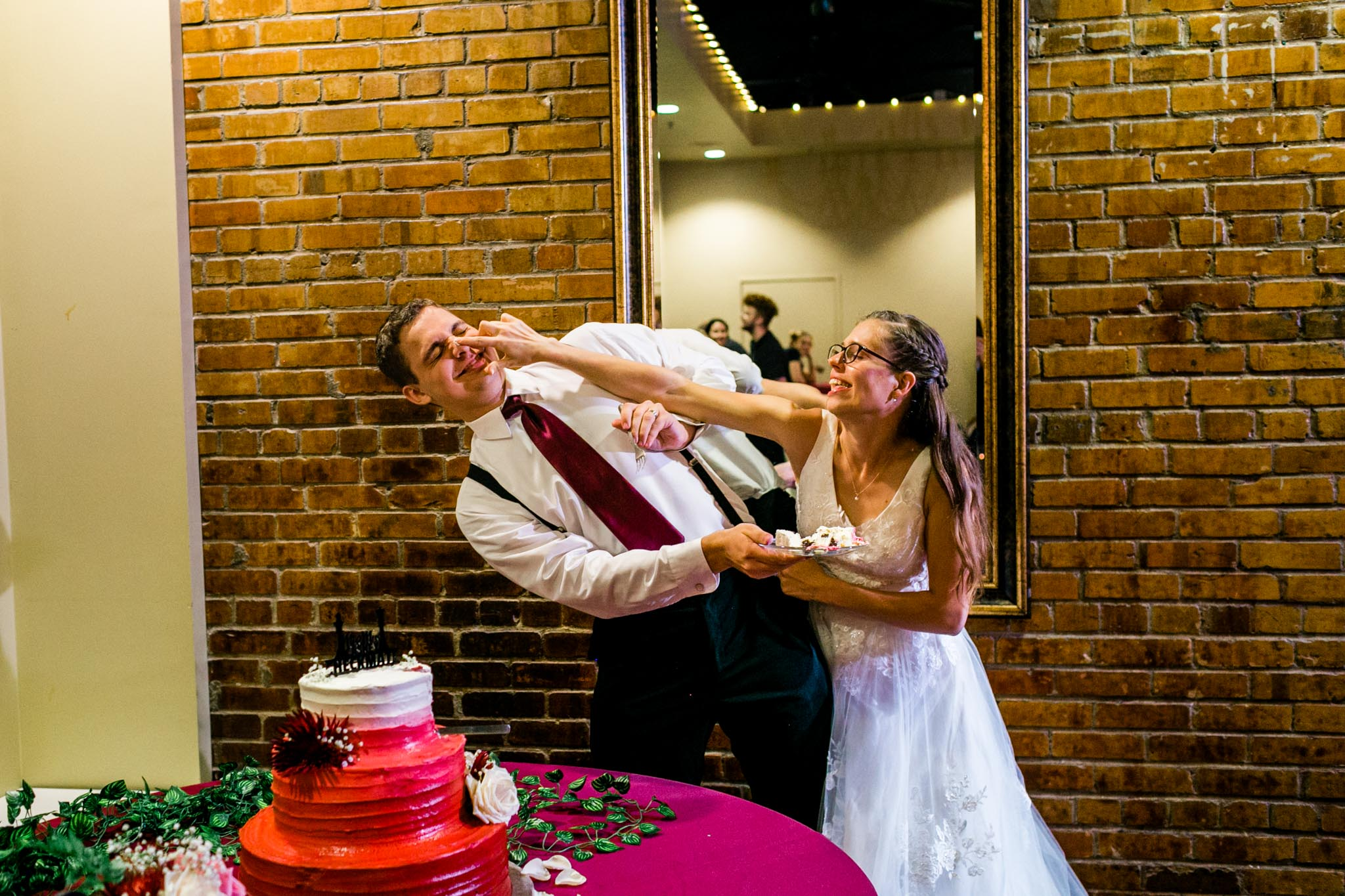 Bride and groom feeding cake to each other | Raleigh Wedding Photographer | By G. Lin Photography
