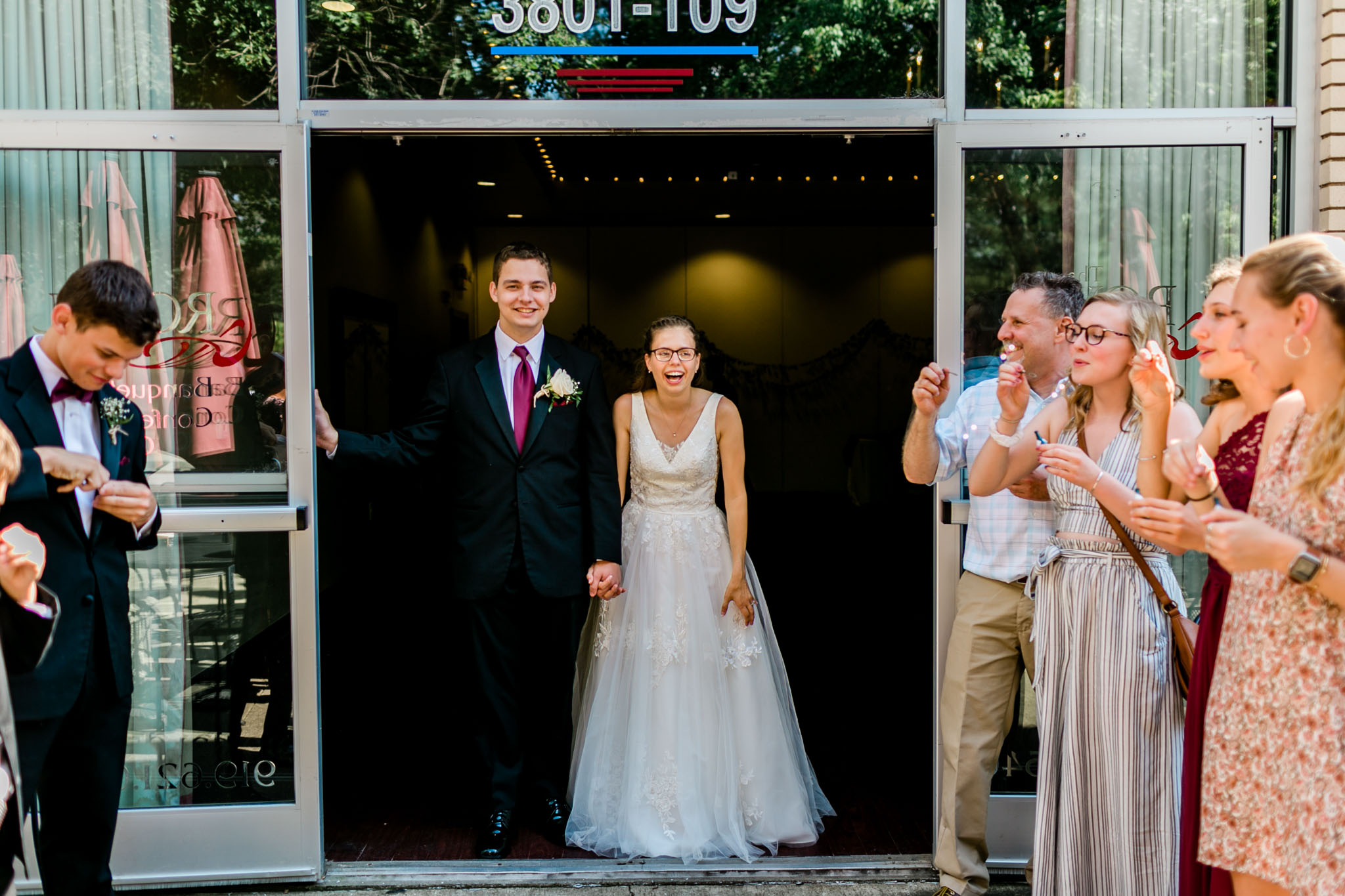 Bride and groom ready for sendoff | Royal Banquet Conference Center | Raleigh Wedding Photographer | By G. Lin Photography