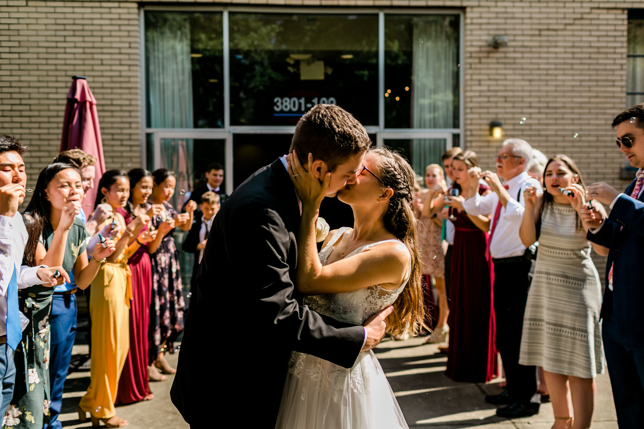 Sendoff kiss of bride and groom | Royal Banquet Conference Center | Raleigh Wedding Photographer | By G. Lin Photography