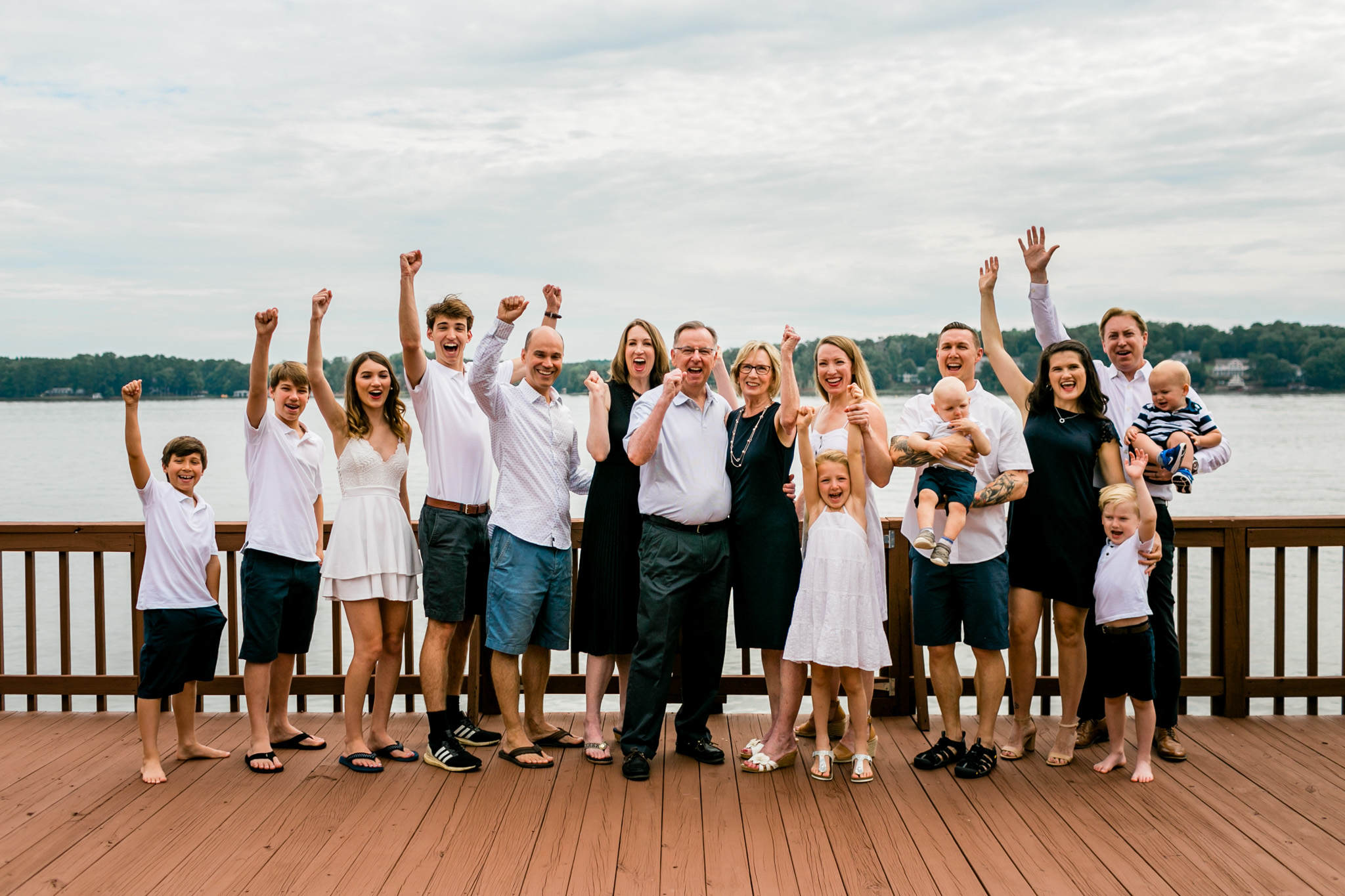 Group family portrait on dock at Lake Gaston cheering | Durham Family Photographer | By G. Lin Photography
