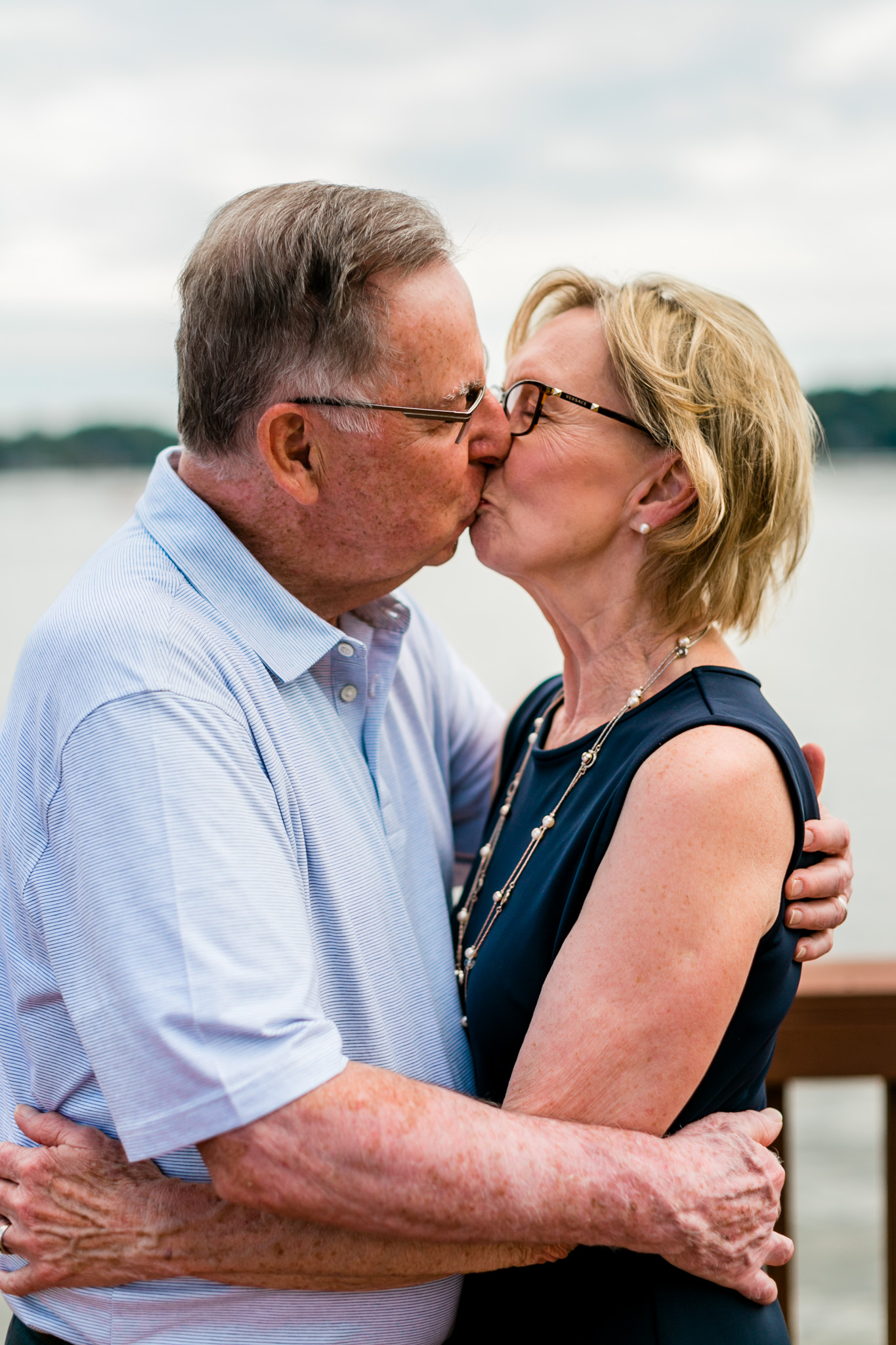 50th wedding anniversary of couple kissing | Raleigh Family Photographer | By G. Lin Photography