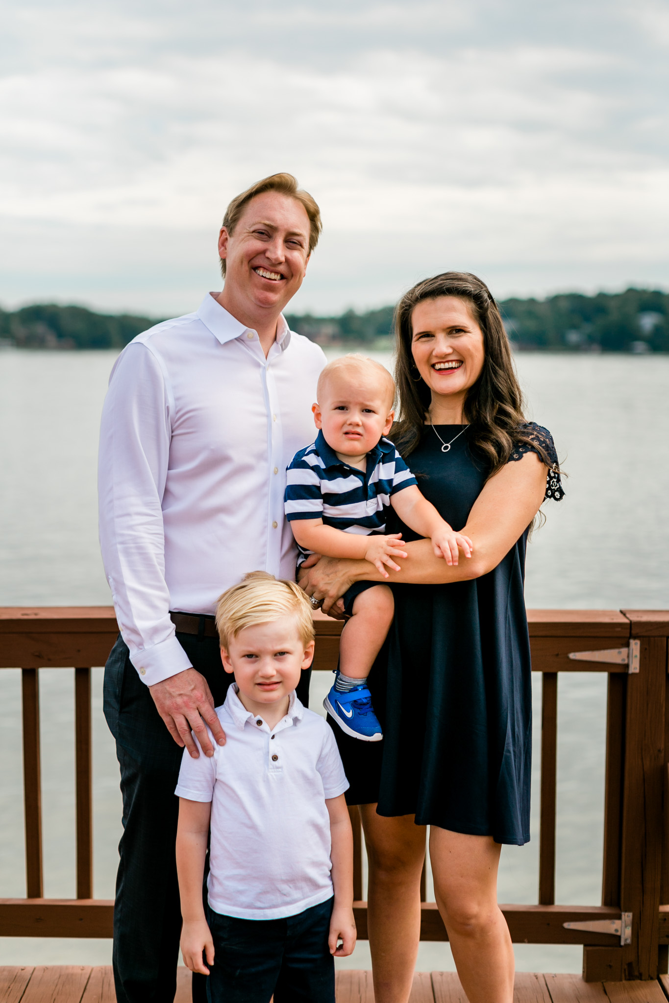 Raleigh Family Photographer | By G. Lin Photography | Family of four standing on dock Lake Gaston