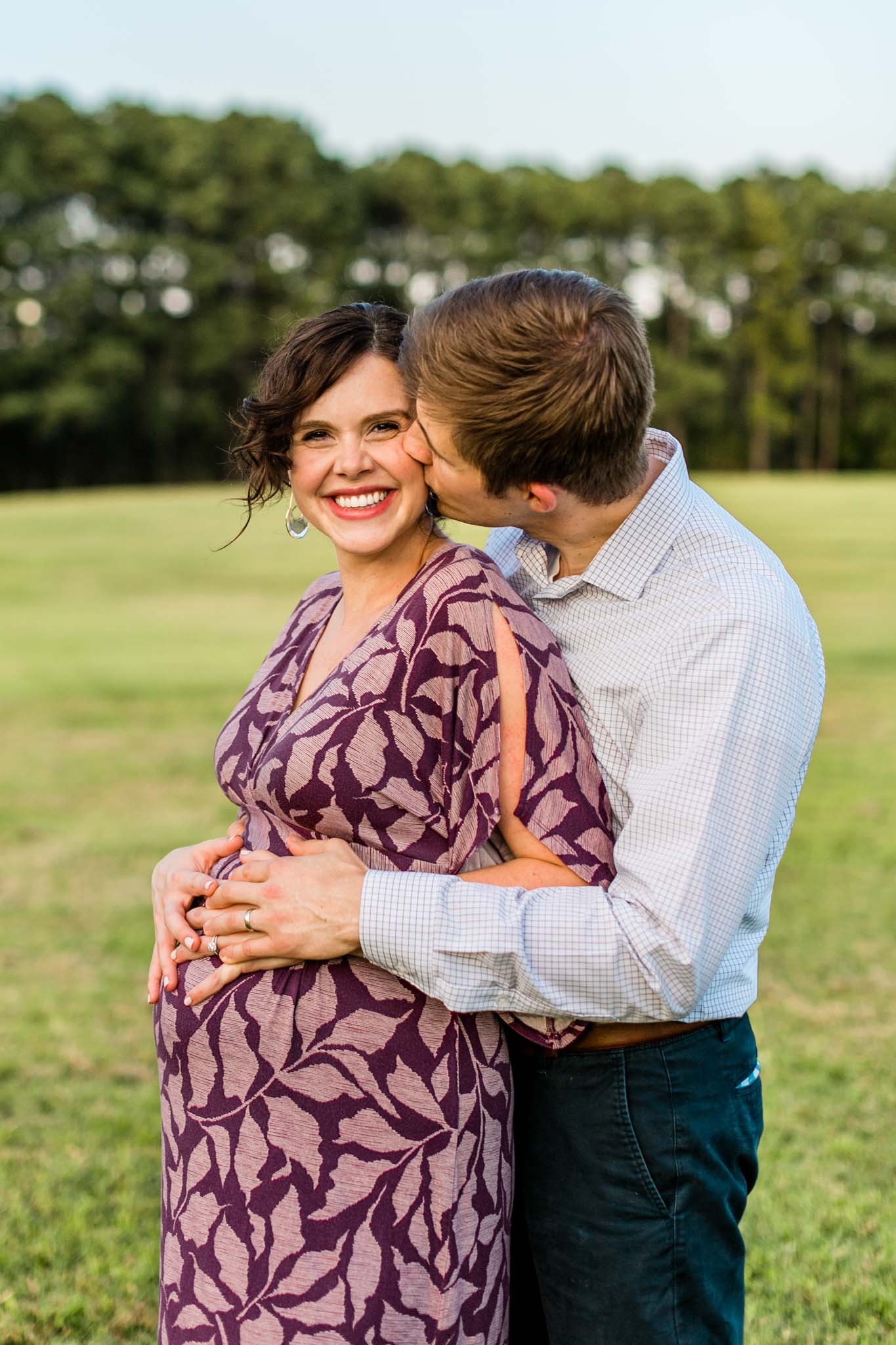 Raleigh Maternity Photographer at Dix Park   By G. Lin Photography   Husband kissing and hugging wife